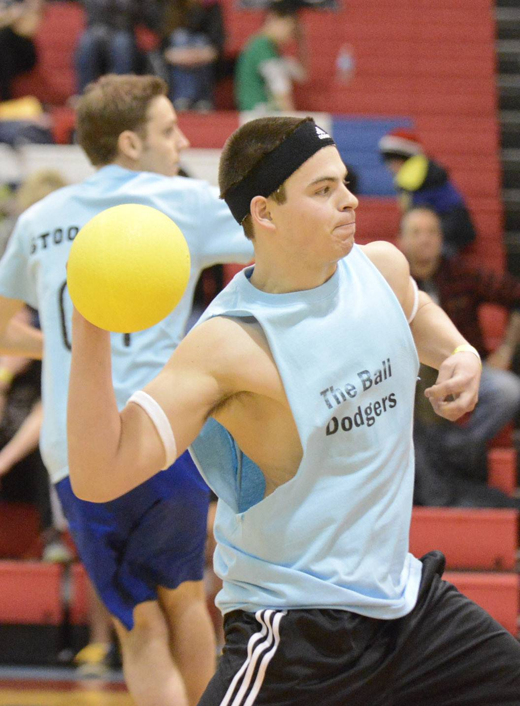 Justin Becker of West Dundee winds up to whip a ball at team Tropic Thunder during the dodgeball tournament at Dundee-Crown High School in Carpentersville on Saturday. He is a member of The Ball Dodgers, made up of 2012 alumni of Dundee-Crown.