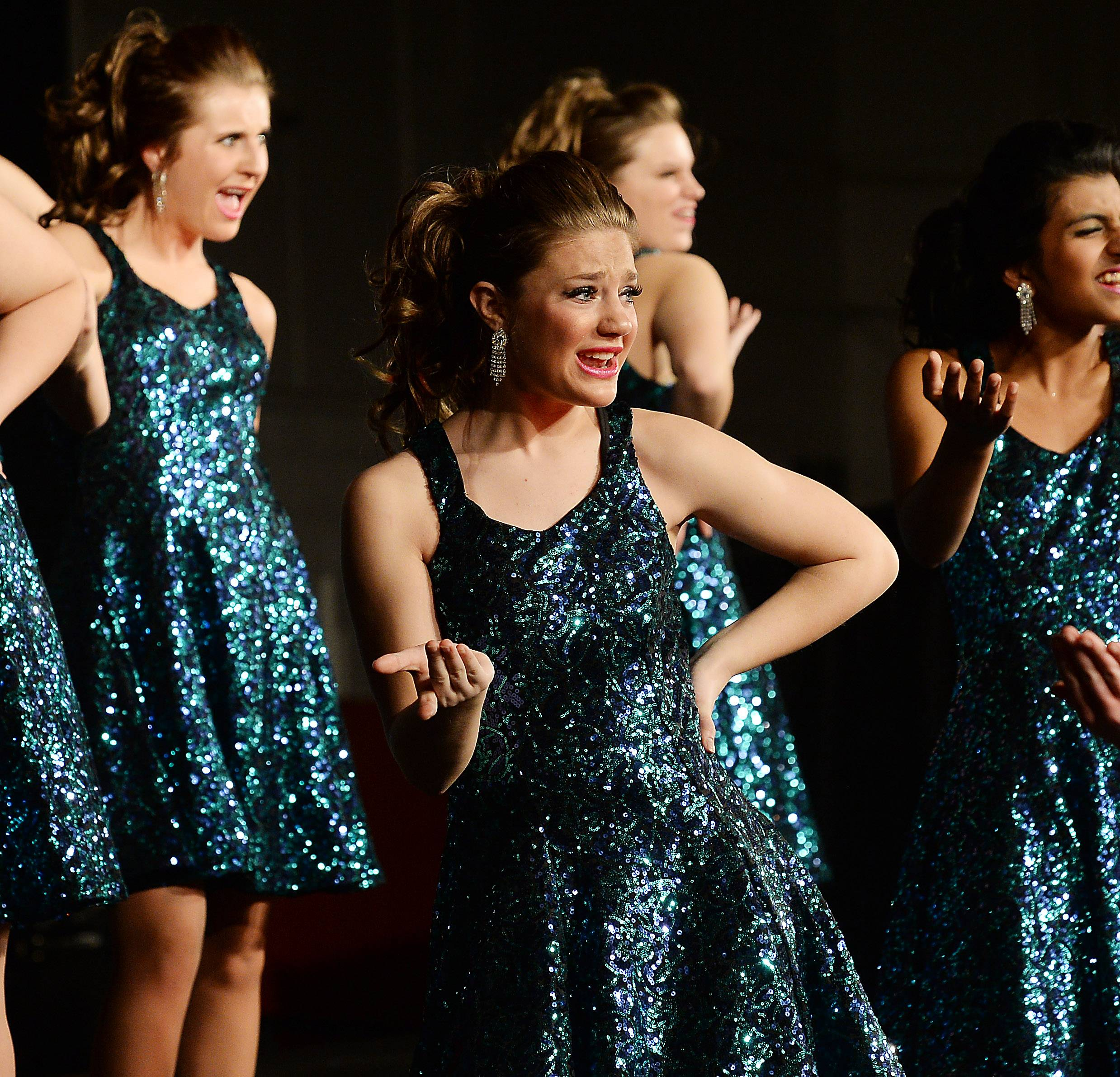 Joleen Adams sings and dances with the Hersey Grove High School choir Ladies First at the Chicagoland Showcase 2014 at Hersey High School on Saturday.