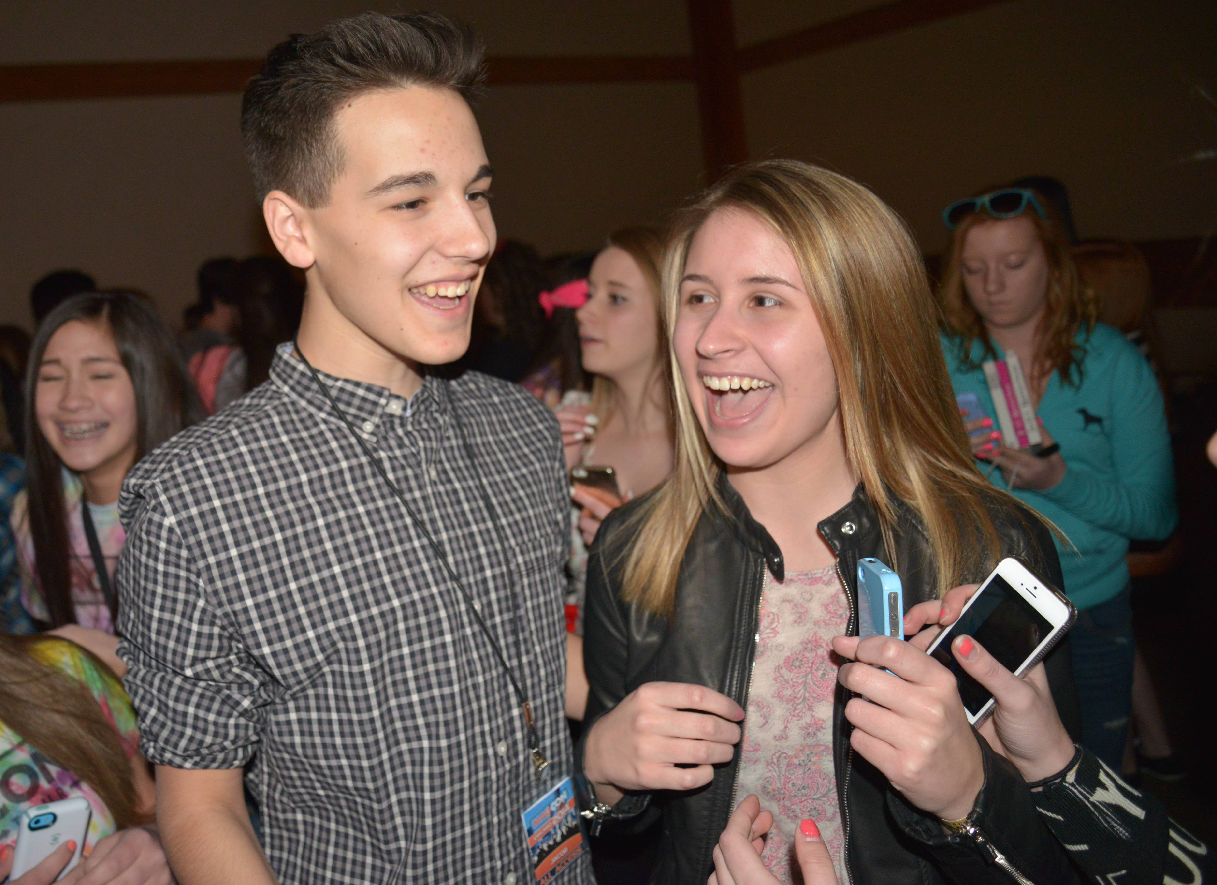 Cameron Dallas, left, takes some time to chat with Rylee Reed, 16, of Chesterton, Ind., at MAGCON in Itasca Saturday.