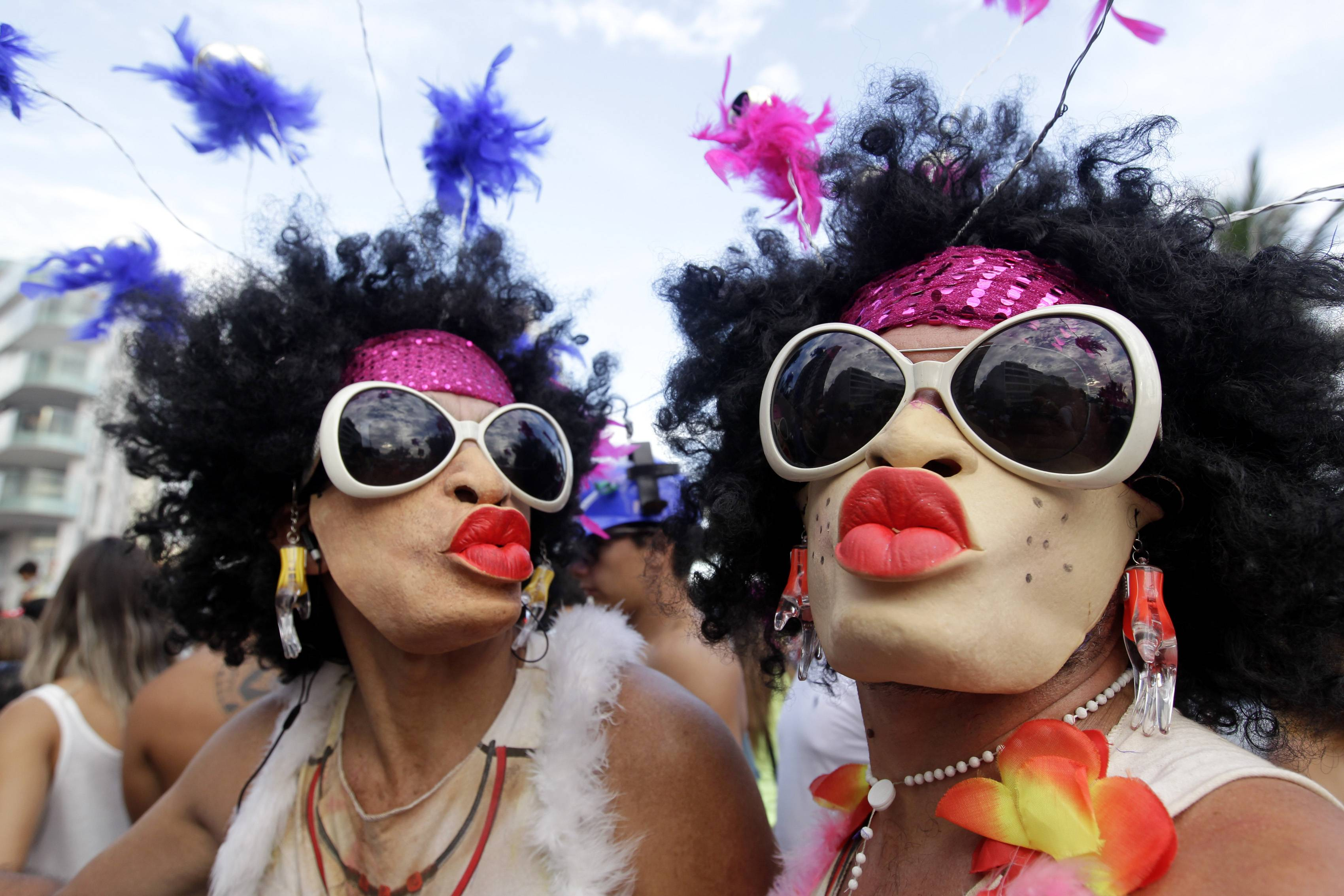 Mask-wearing revelers pose for a photo Saturday during the the Banda de Ipanema Carnival parade in Rio de Janeiro, Brazil.