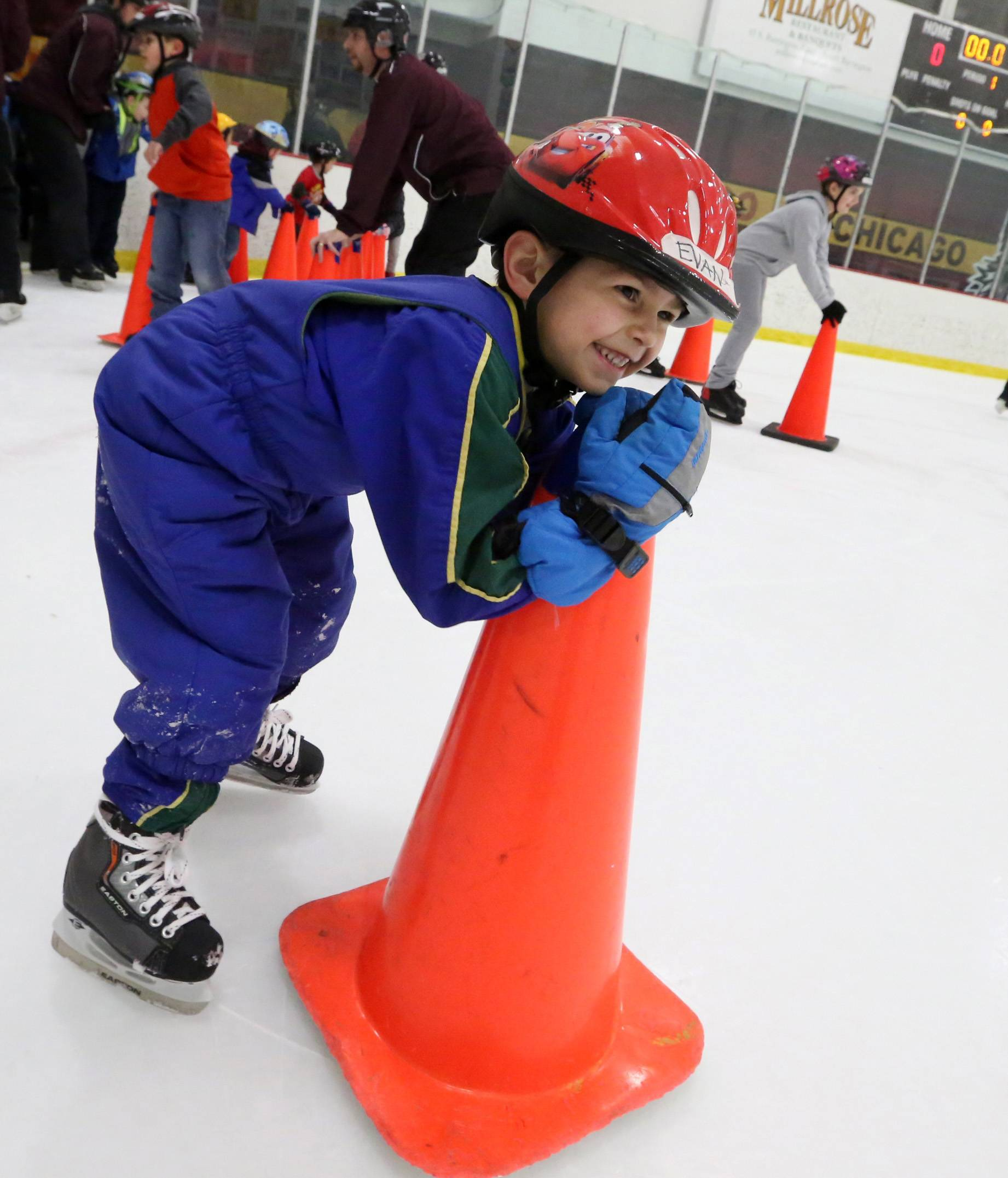 Evan Sher, 5, of Hanover Park, learns to stay up on his skates using an orange traffic cone at USA Hockey's annual Try Hockey For Free event at the Triphahn Center on Saturday in Hoffman Estates.