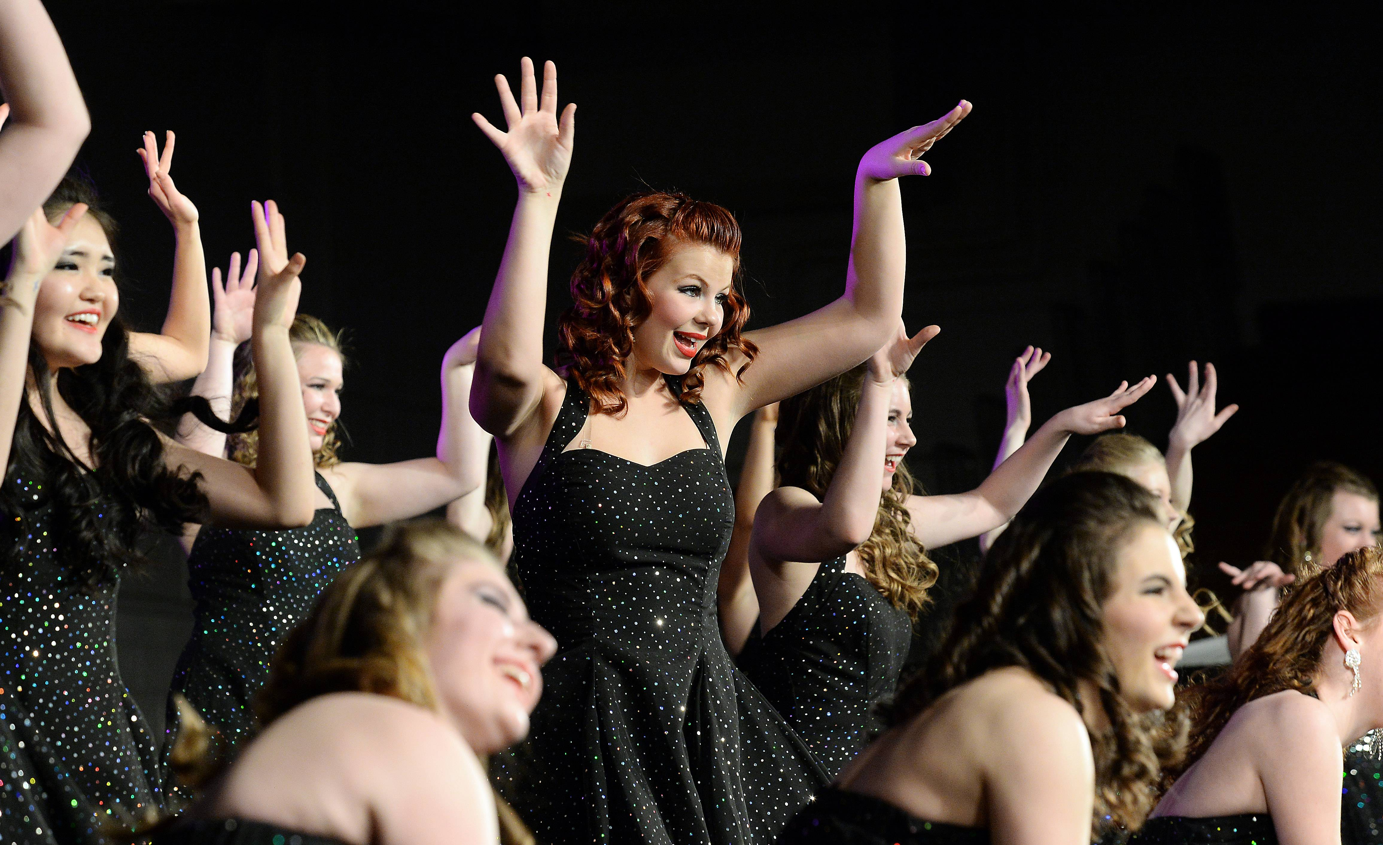 Meghan Rose sings with Company, the Prospect High School show choir, during the Chicagoland Showcase show choir competition Saturday in Arlington Heights.