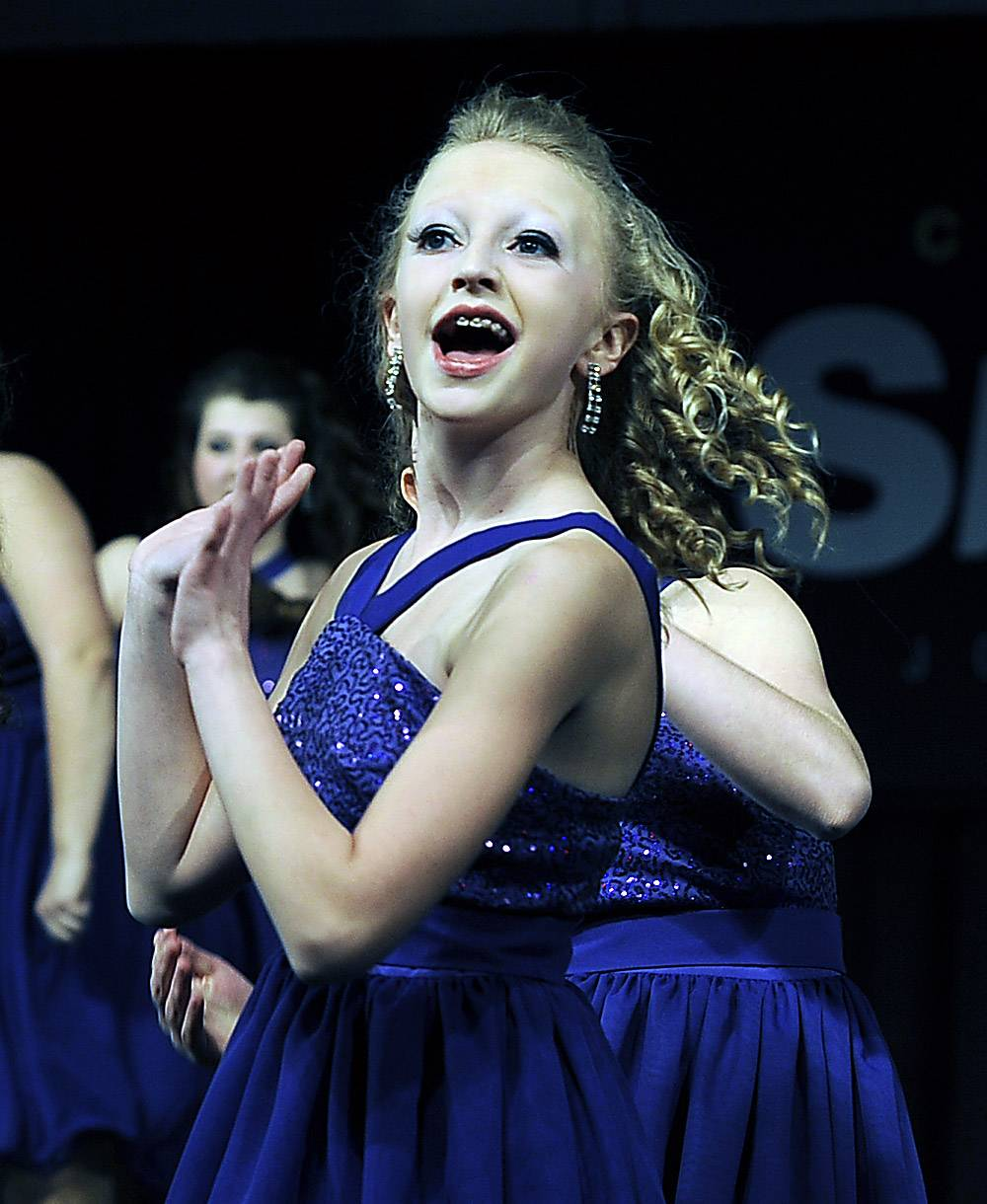 Cassady Chadwell leads Legacy, the Batavia High School show choir, during a performance at the Chicagoland Showcase show choir competition Saturday in Arlington Heights.