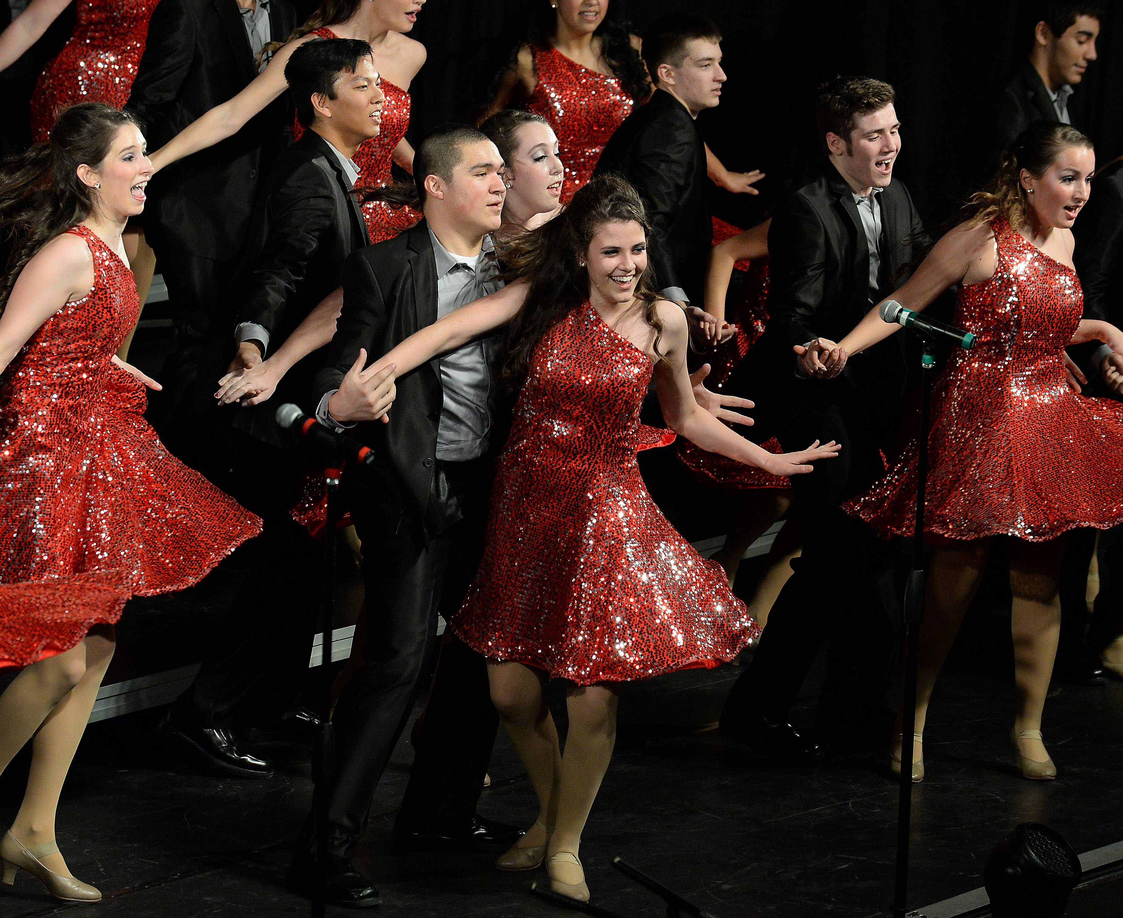 Maggie Monaxios sings and dances with partner Sam Yoshino during a performance by Legacy, the Wheeling High School show choir, at Chicagoland Showcase on Saturday. The show choir competition was held at Hersey High School in Arlington Heights.