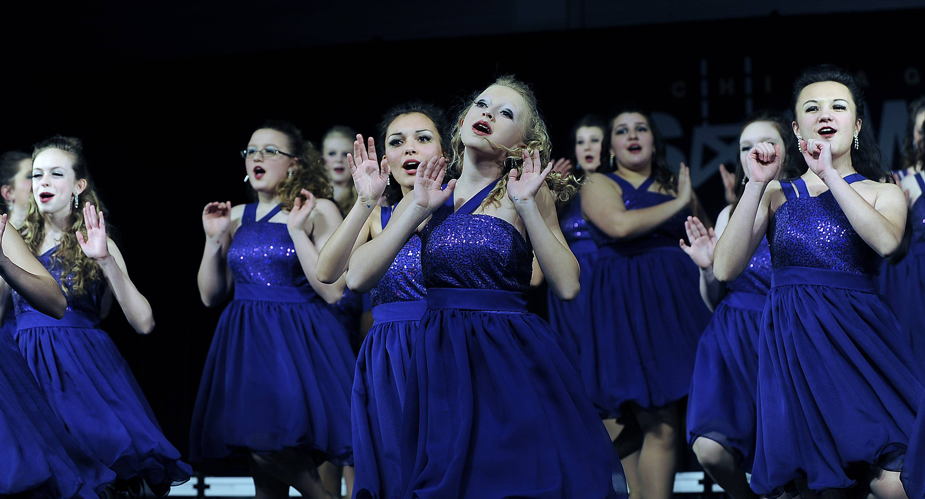 Cassady Chadwell leads the Batavia High School choir Legacy at the Chicagoland Showcase 2014 at Hersey High School on Saturday.
