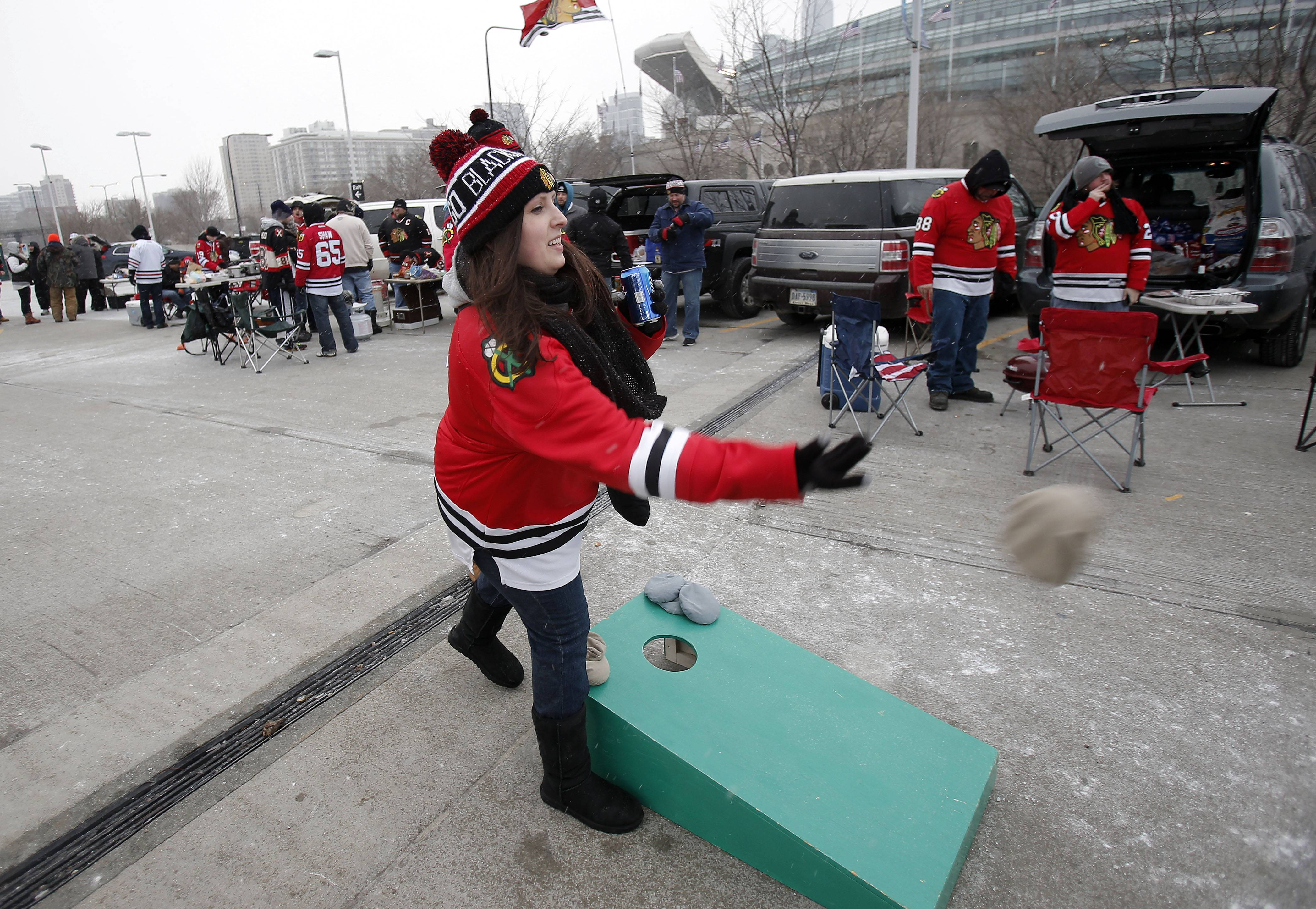 Maureen Meyer of Bloomingdale plays a bags game prior to the Blackhawks vs Penguins NHL Stadium Series Saturday at Soldier Field.
