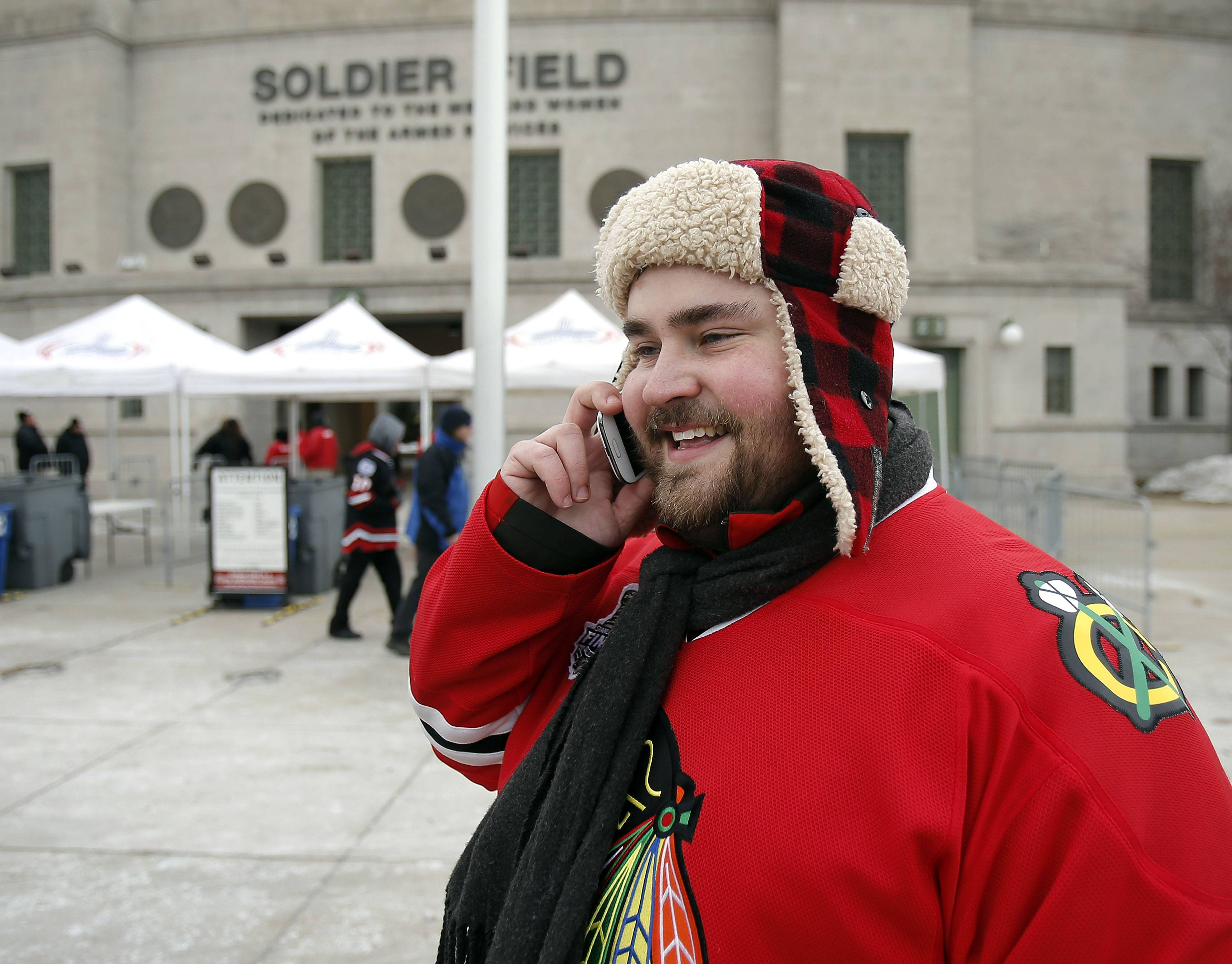Erik Ambrus of Mount Prospect talks on the phone Soldier Field prior to the Blackhawks vs Penguins NHL Stadium Series Saturday.