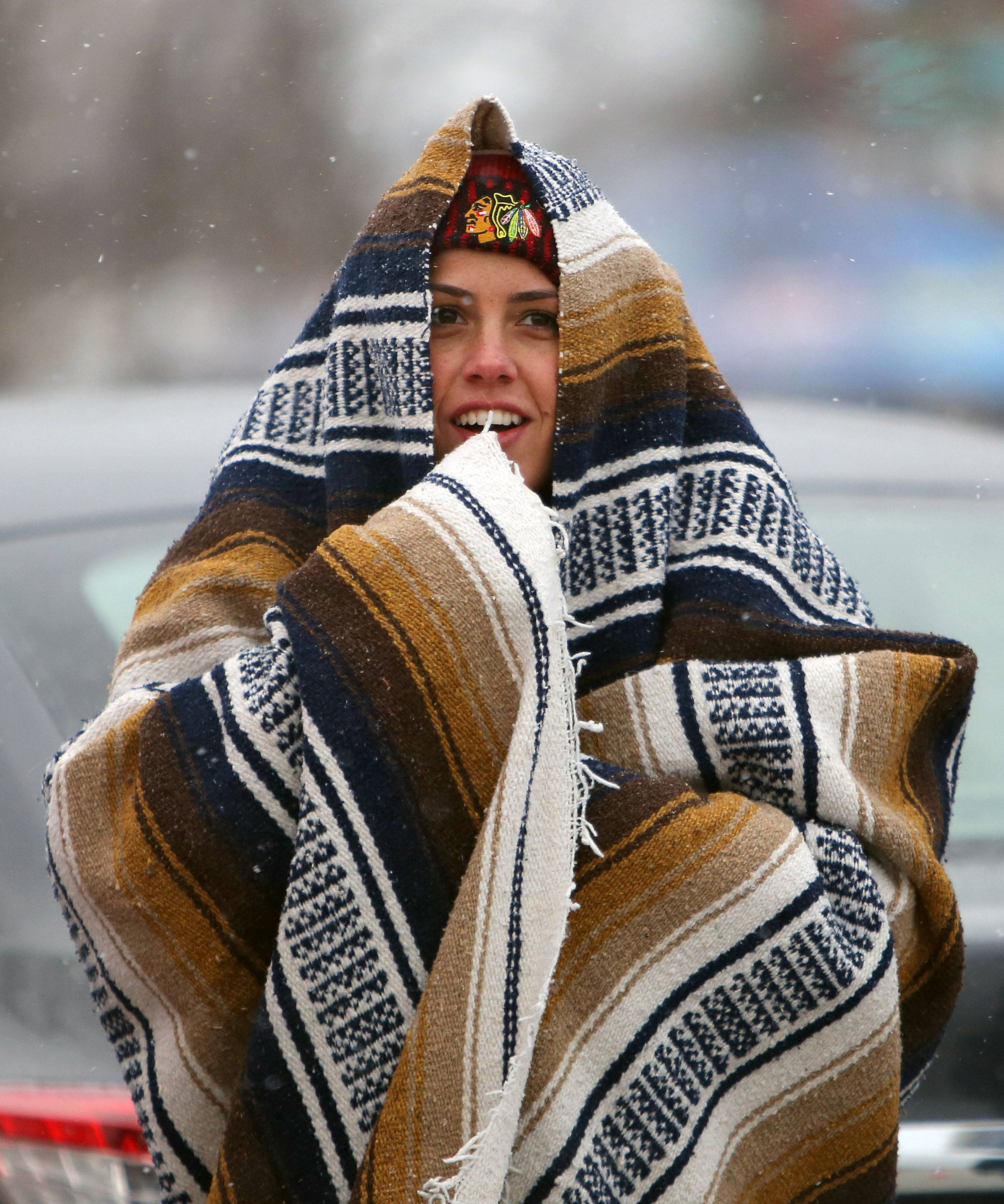 Vanessa Thompson of Lemont bundles up prior to the Blackhawks vs Penguins NHL Stadium Series Saturday at Soldier Field.