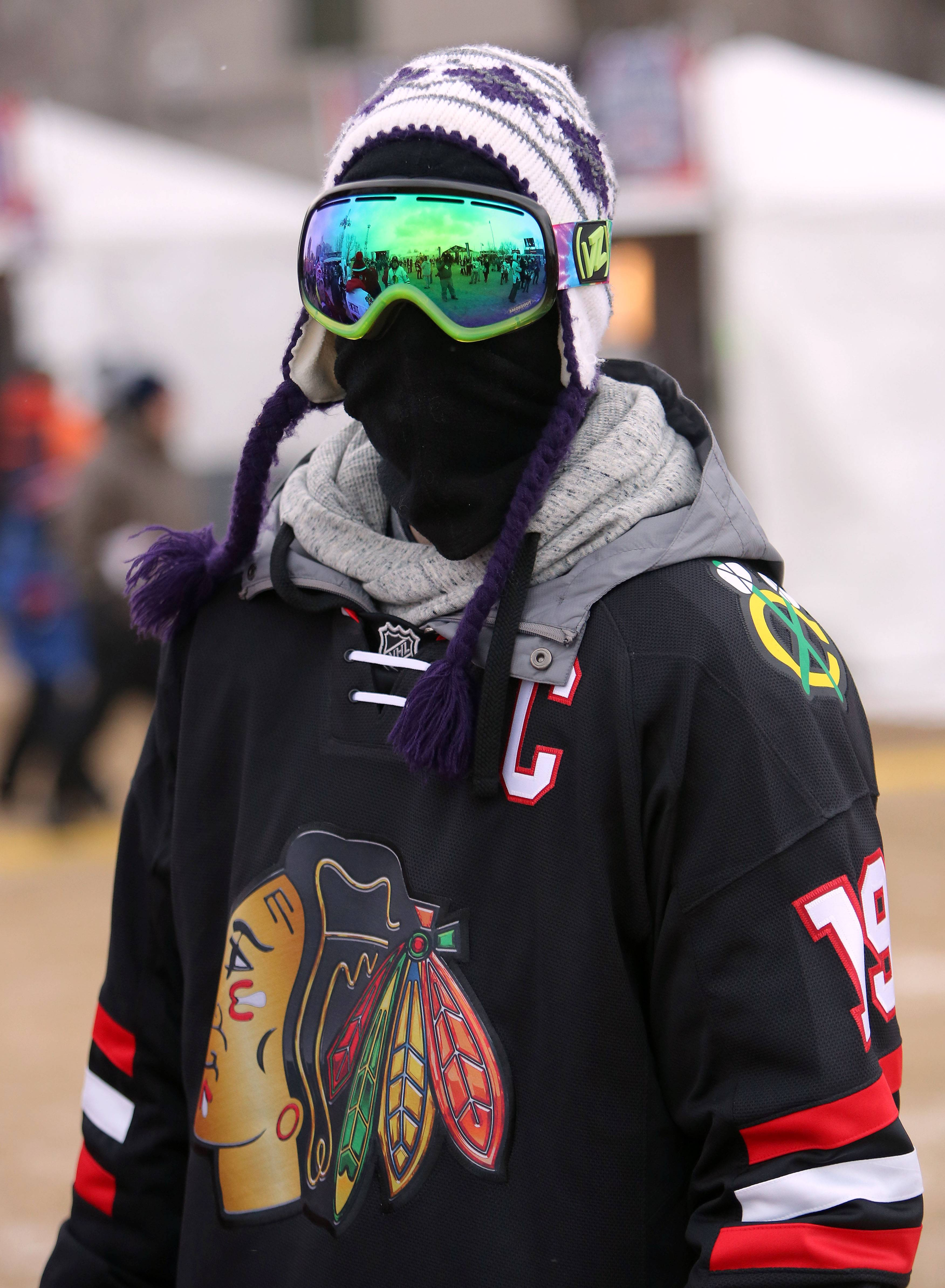 Danny Anderson has every inch of skin covered prior to the Blackhawks vs Penguins NHL Stadium Series Saturday at Soldier Field.