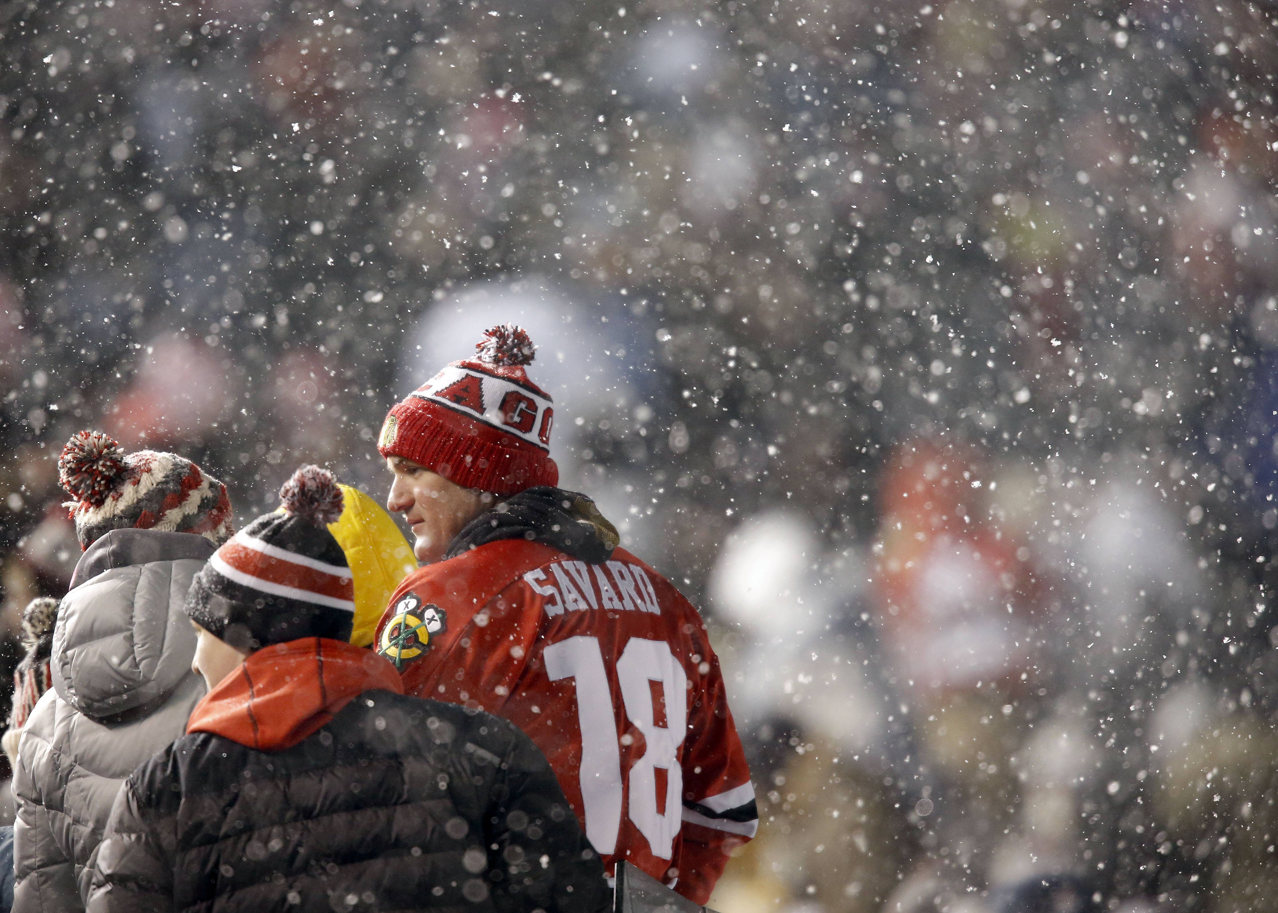 Snow covers Soldier Field during the NHL Stadium Series between the Blackhawks and the Penguins Saturday.