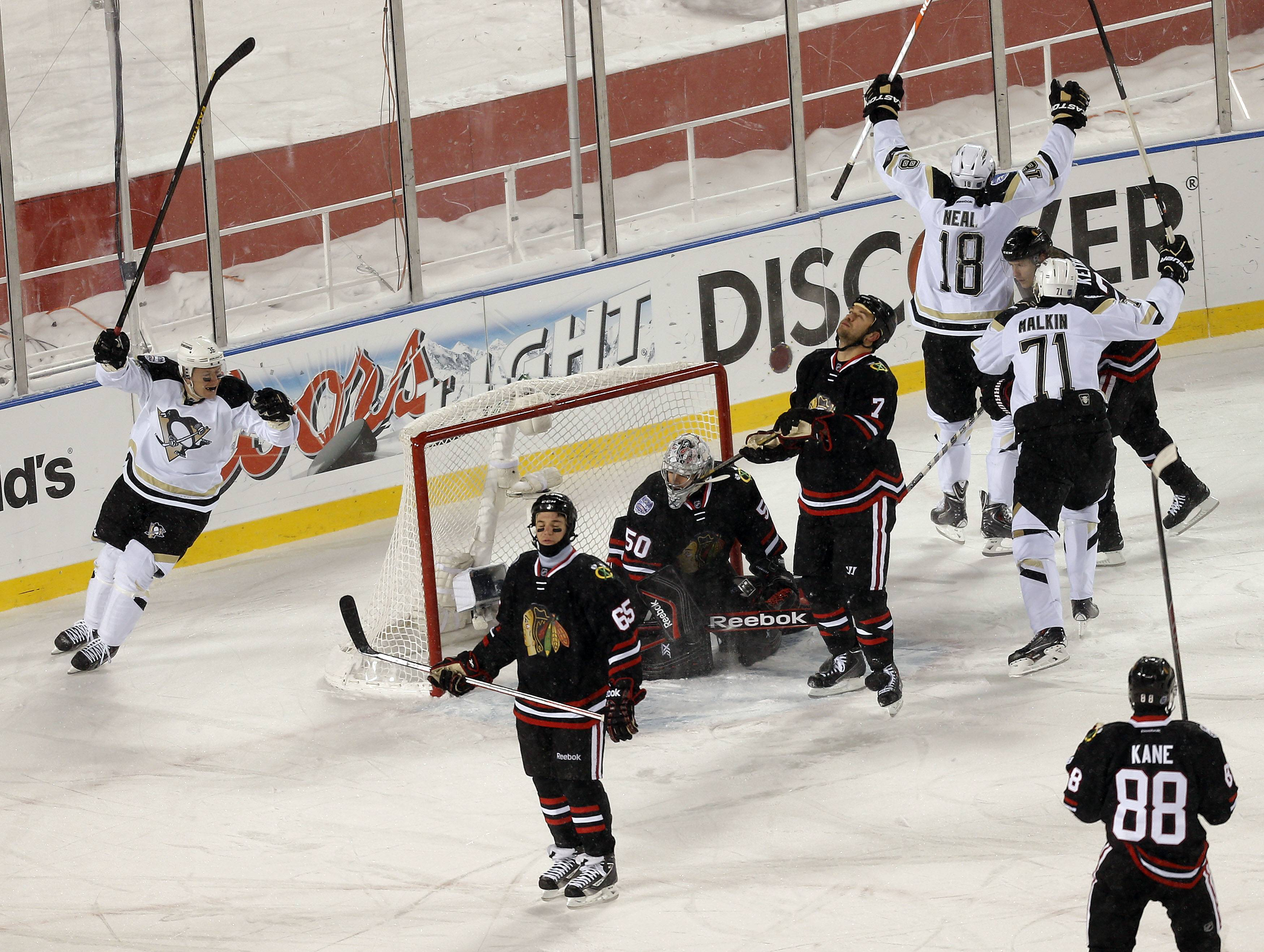 Pittsburg players react after scoring in the third period during the NHL Stadium Series between the Blackhawks and the Penguins Saturday at Soldier Field.
