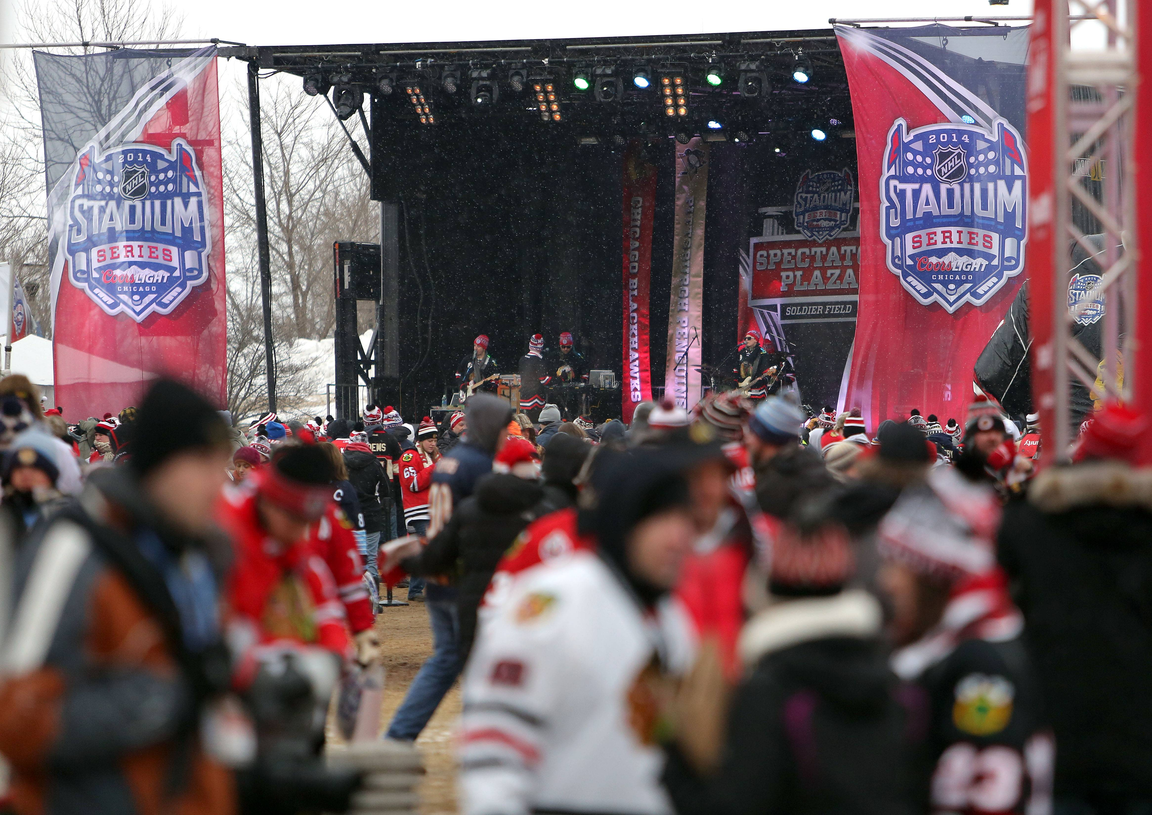 People attend the spectators plaza prior to the Blackhawks vs Penguins NHL Stadium Series Saturday at Soldier Field.