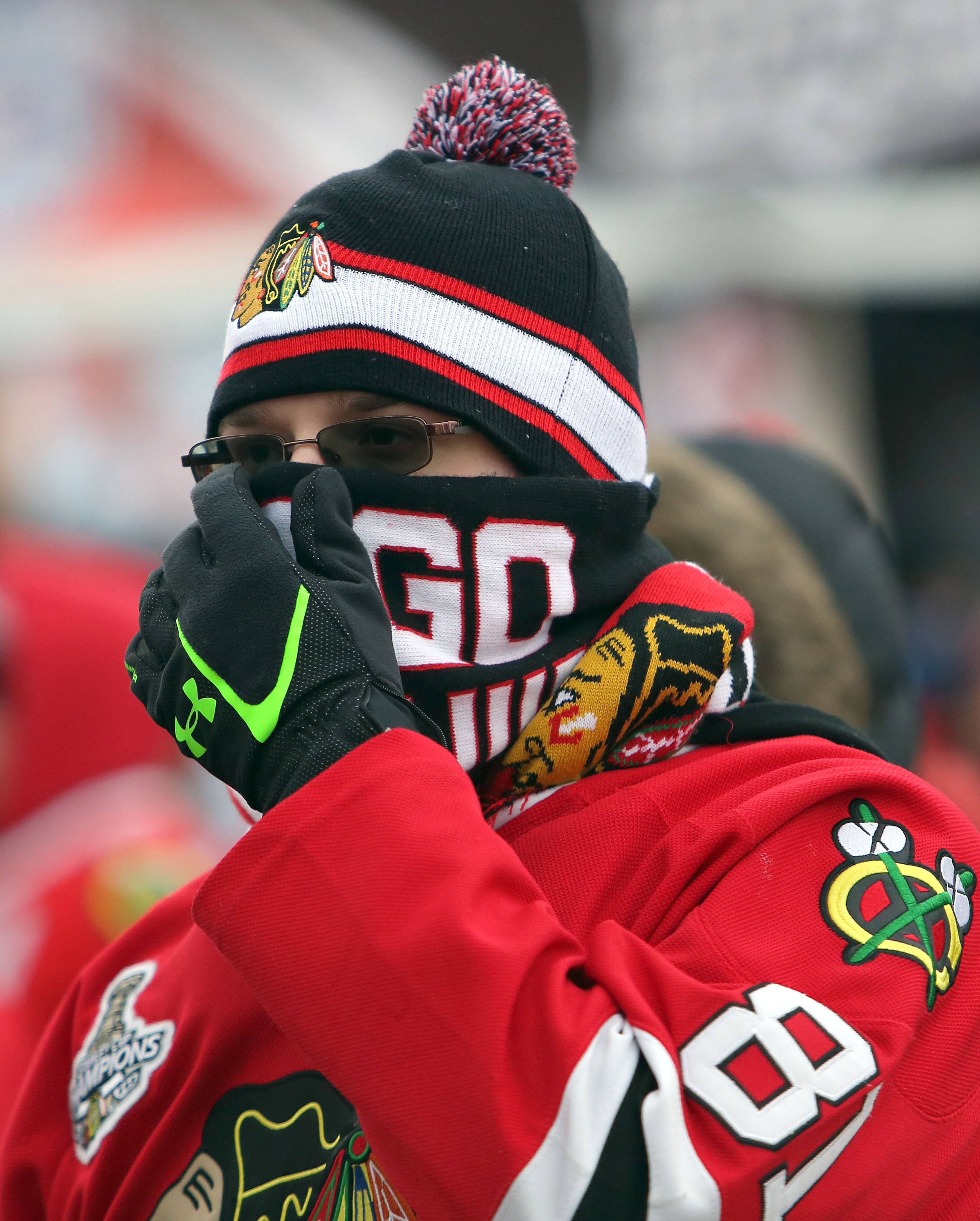 Tim Buczkowski of Pittsburg, Pennsylvania covers his face as he hangs out in the spectator plaza prior to the Blackhawks vs Penguins NHL Stadium Series Saturday at Soldier Field.