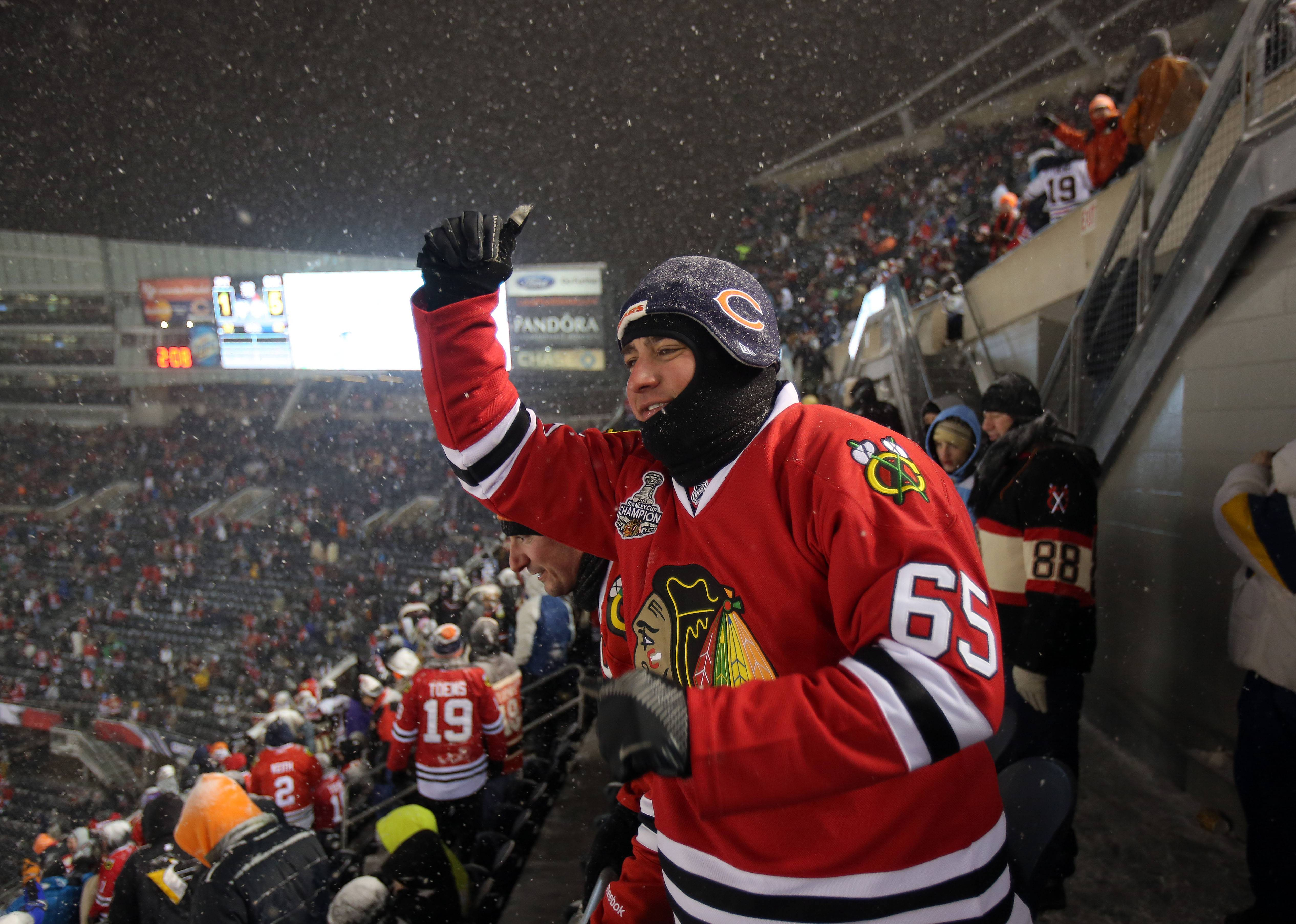 Gregg Braun of Glendale Heights dances after the Blackhawks beat the Penguins 5-1 in the NHL Stadium Series Saturday at Soldier Field.
