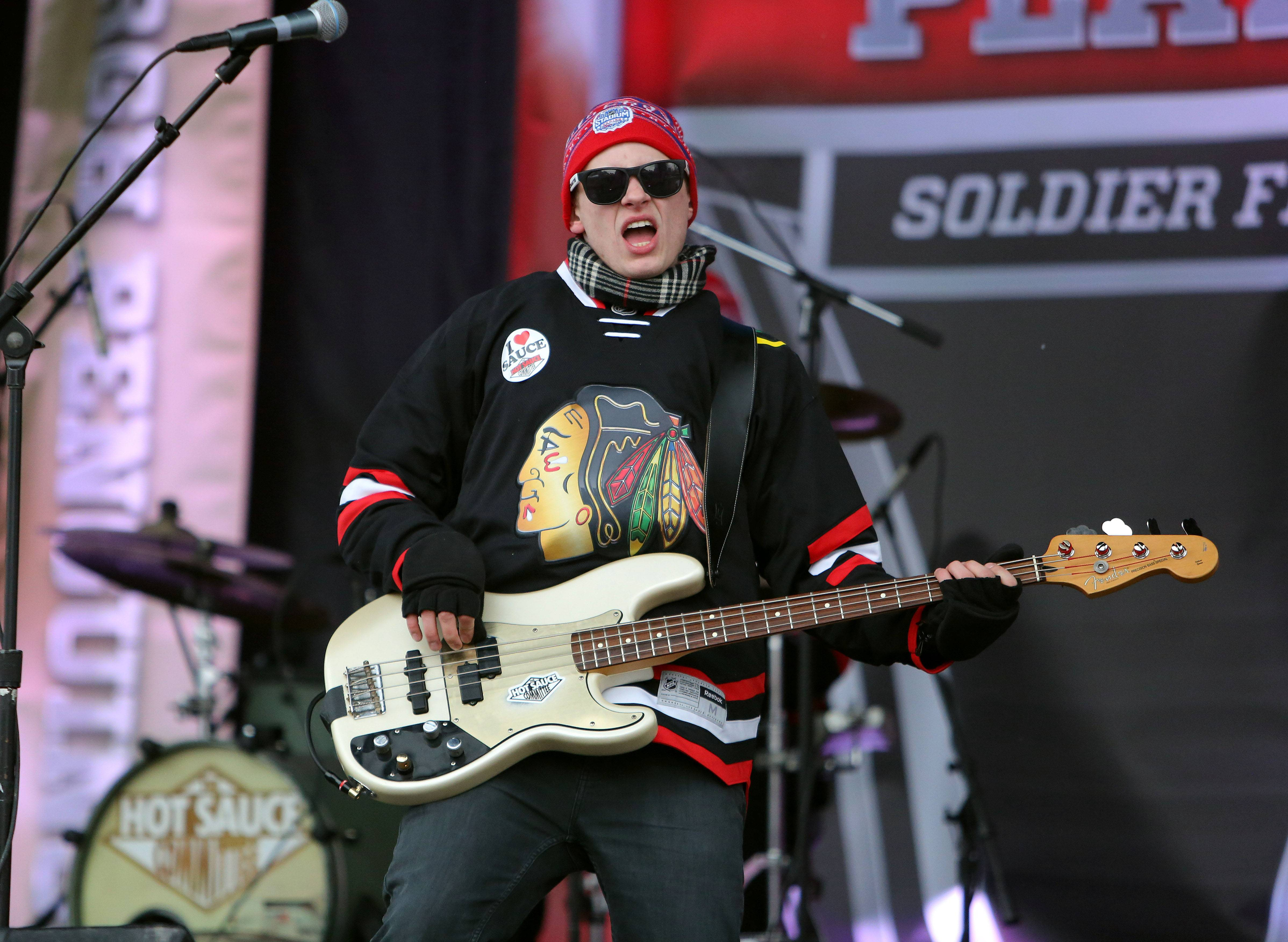 Hot Sauce performs in the spectators plaza prior to the Blackhawks vs Penguins NHL Stadium Series Saturday at Soldier Field.