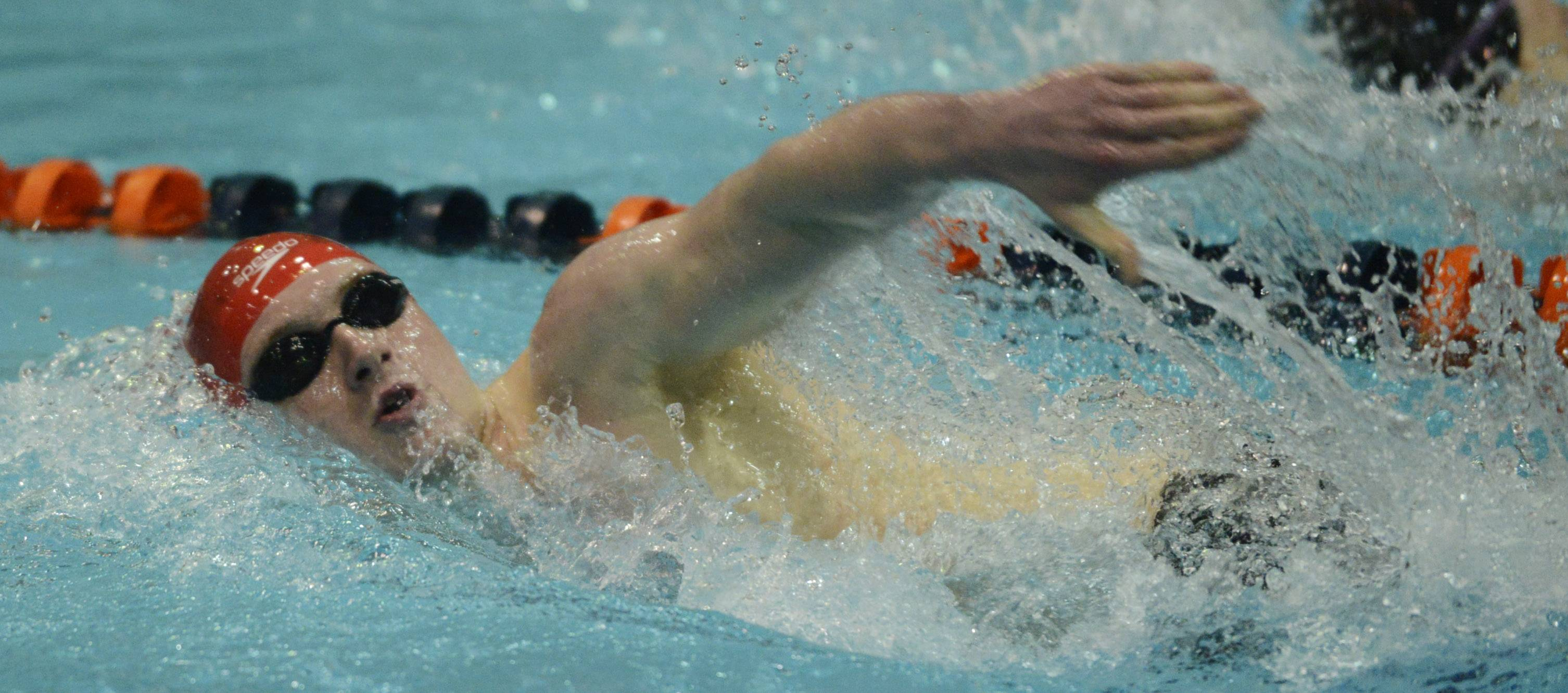 Naperville Central's Connor Lamb swims in the consolation finals of the 500-yard freestyle during the boys state swimming meet at Evanston High School Saturday.