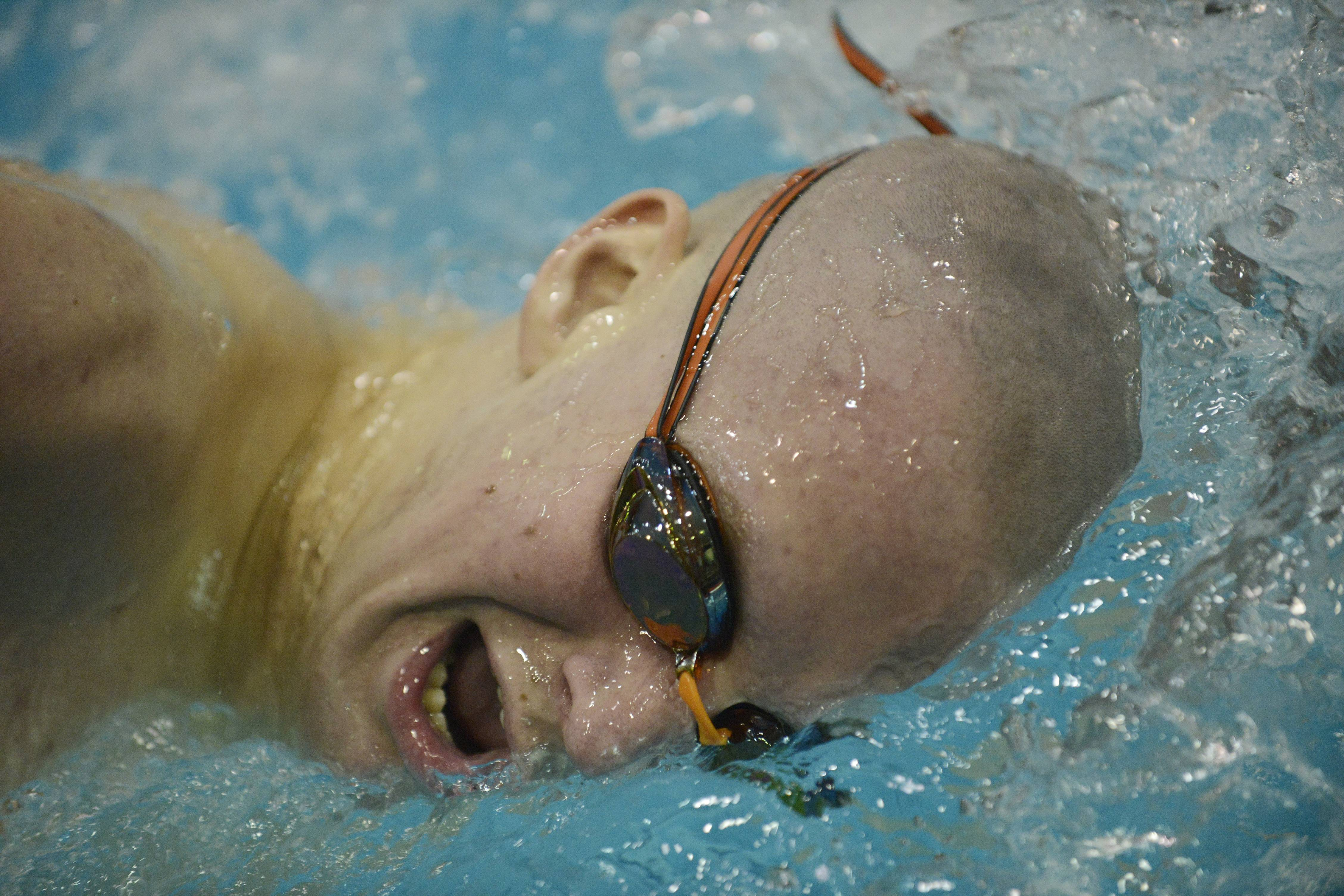St. Charles East's Will Shanel swims toward a fourth-place finish in the 500-yard freestyle during the boys state swimming meet at Evanston High School Saturday.