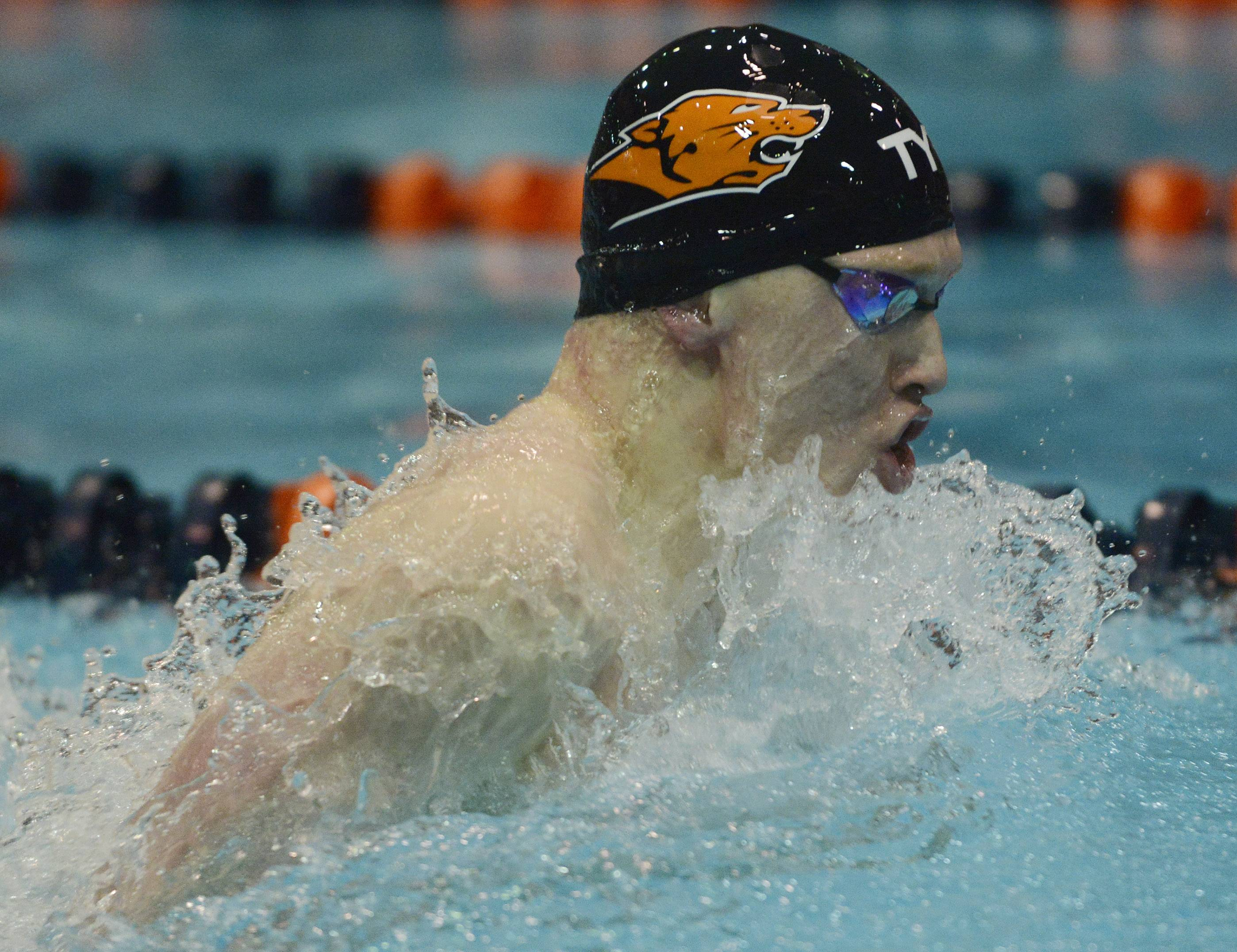 Libertyville's Bobby Snader swims the breaststroke leg of the 200-yard medley relay during the boys state swimming meet at Evanston High School Saturday.