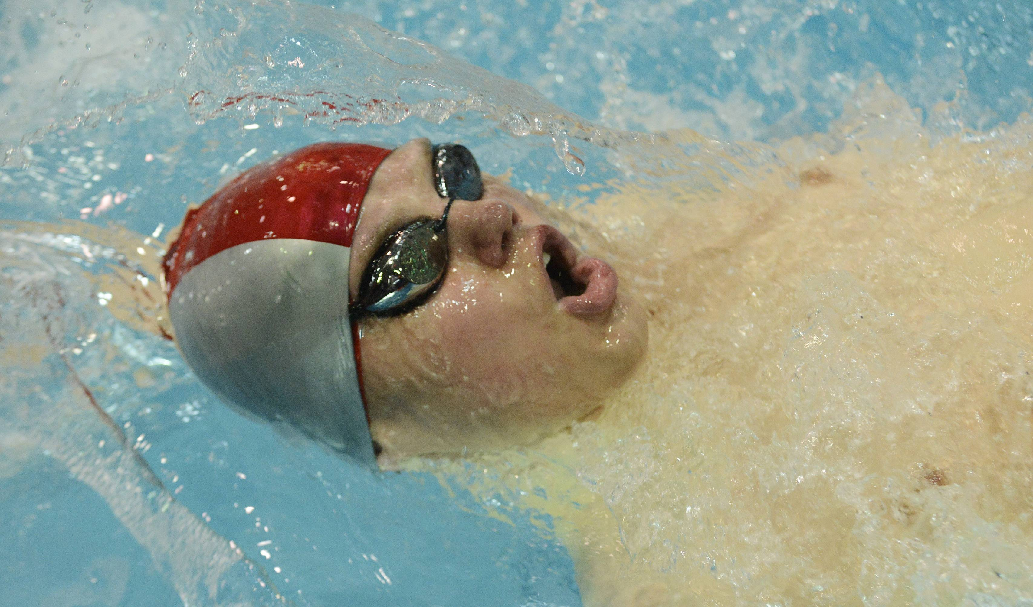 Mundelein's Ayrton Kasemets swims the backstroke portion of the 200-yard individual medley during the boys state swimming meet at Evanston High School Saturday.