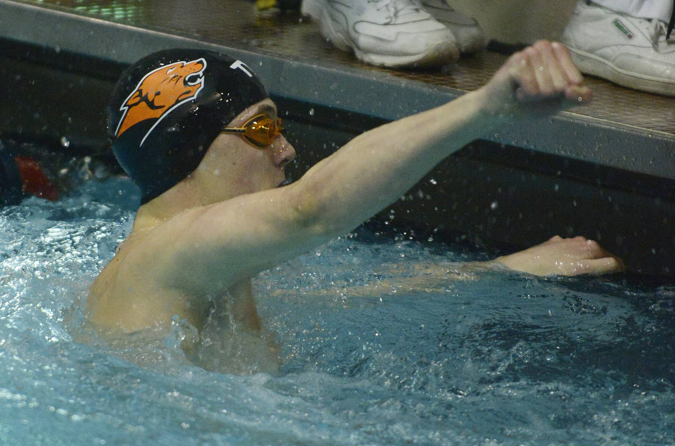 Justin Fu, Libertyville's anchor in the 200-yard medley relay, pumps his fist after his team's record-setting finish during the boys state swimming meet at Evanston High School Saturday.