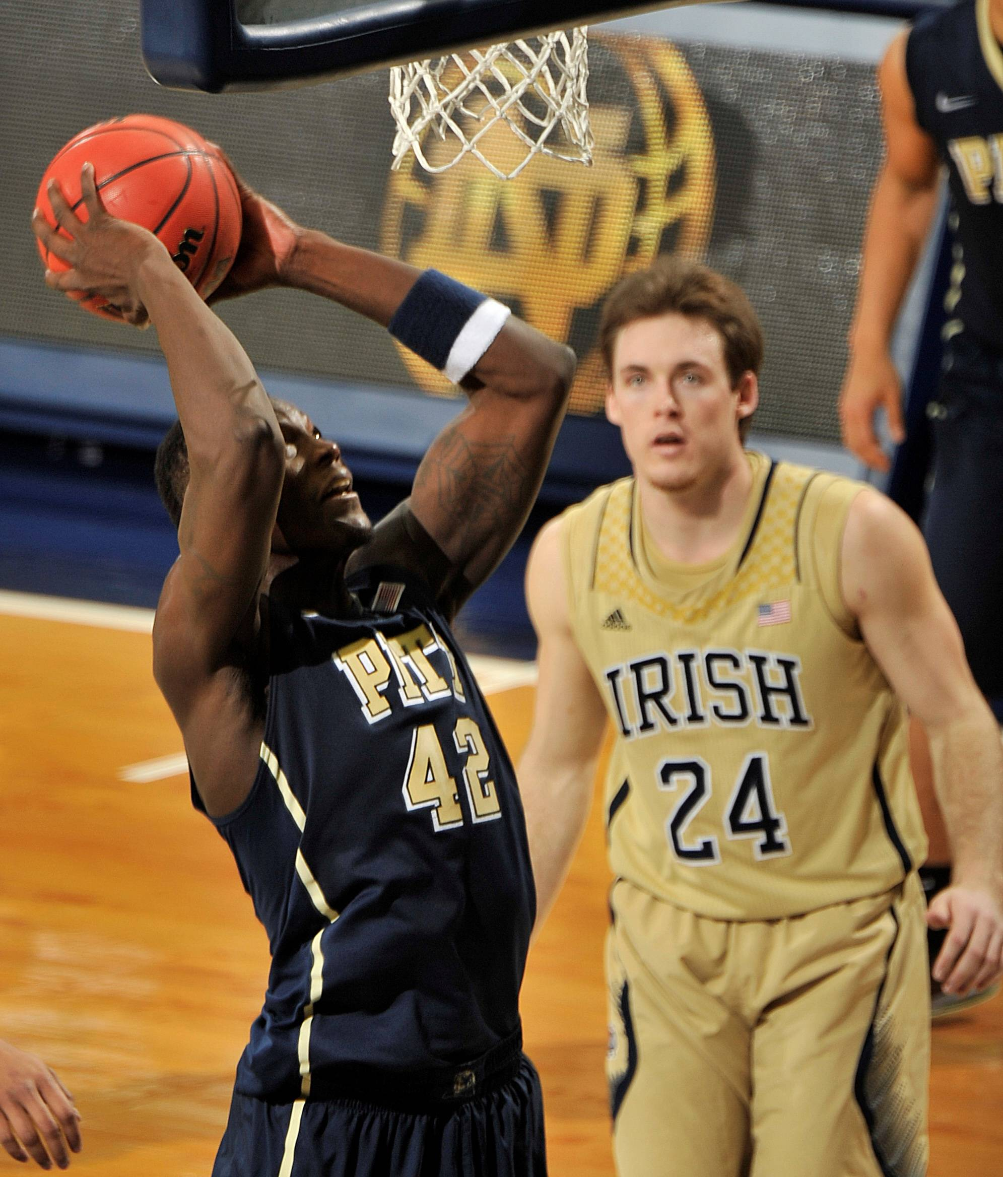 Pittsburgh forward Talib Zanna puts up a shot as Notre Dame guard Pat Connaughton looks on in the second half of an college basketball game Saturday, March 1, 2014 in South Bend, Ind. Pittsburgh won 85-81 in overtime with Zanna scoring 17 points.