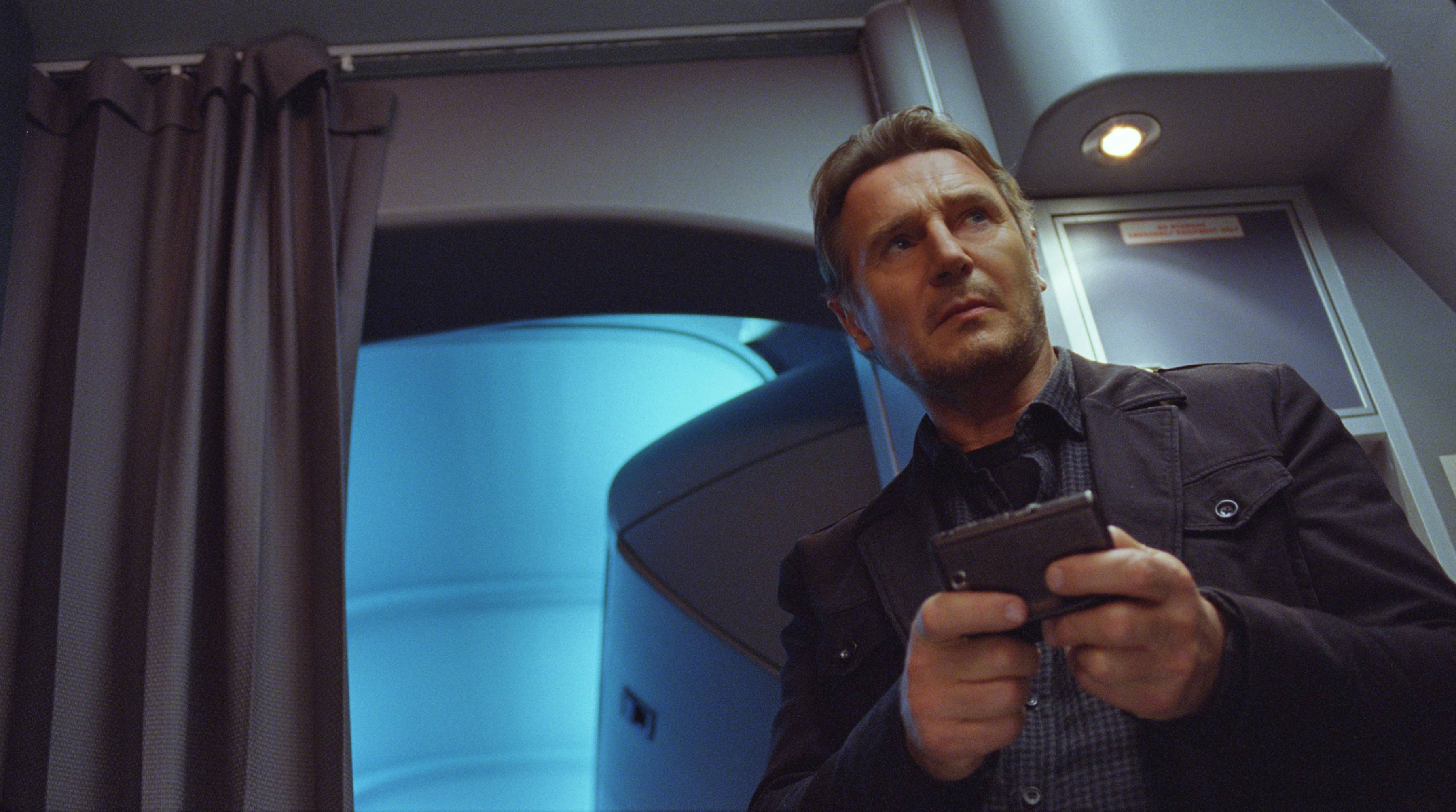 "This image released by Universal Pictures shows Liam Neeson in a scene from ""Non-Stop,"" which came in at No. 1 at the box office breaking the streak of ""The Lego Movie."""