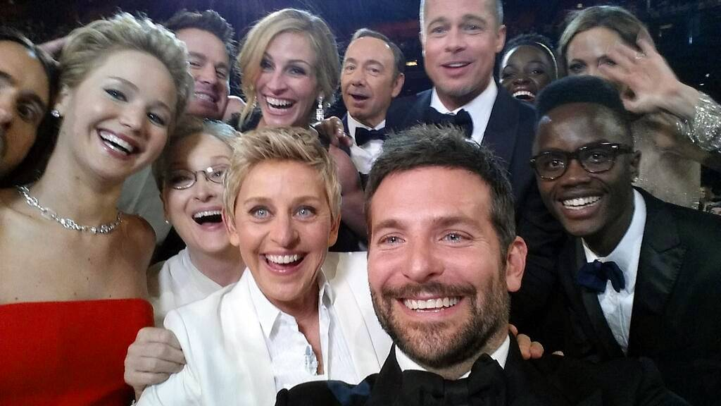 "This image released by Ellen DeGeneres shows actors front row from left, Jared Leto, Jennifer Lawrence, Meryl Streep, Ellen DeGeneres, Bradley Cooper, Peter Nyong'o Jr., and, second row, from left, Channing Tatum, Julia Roberts, Kevin Spacey, Brad Pitt, Lupita Nyong'o and Angelina Jolie as they pose for a ""selfie"" portrait on a cell phone during the Oscars at the Dolby Theatre on Sunday in Los Angeles."