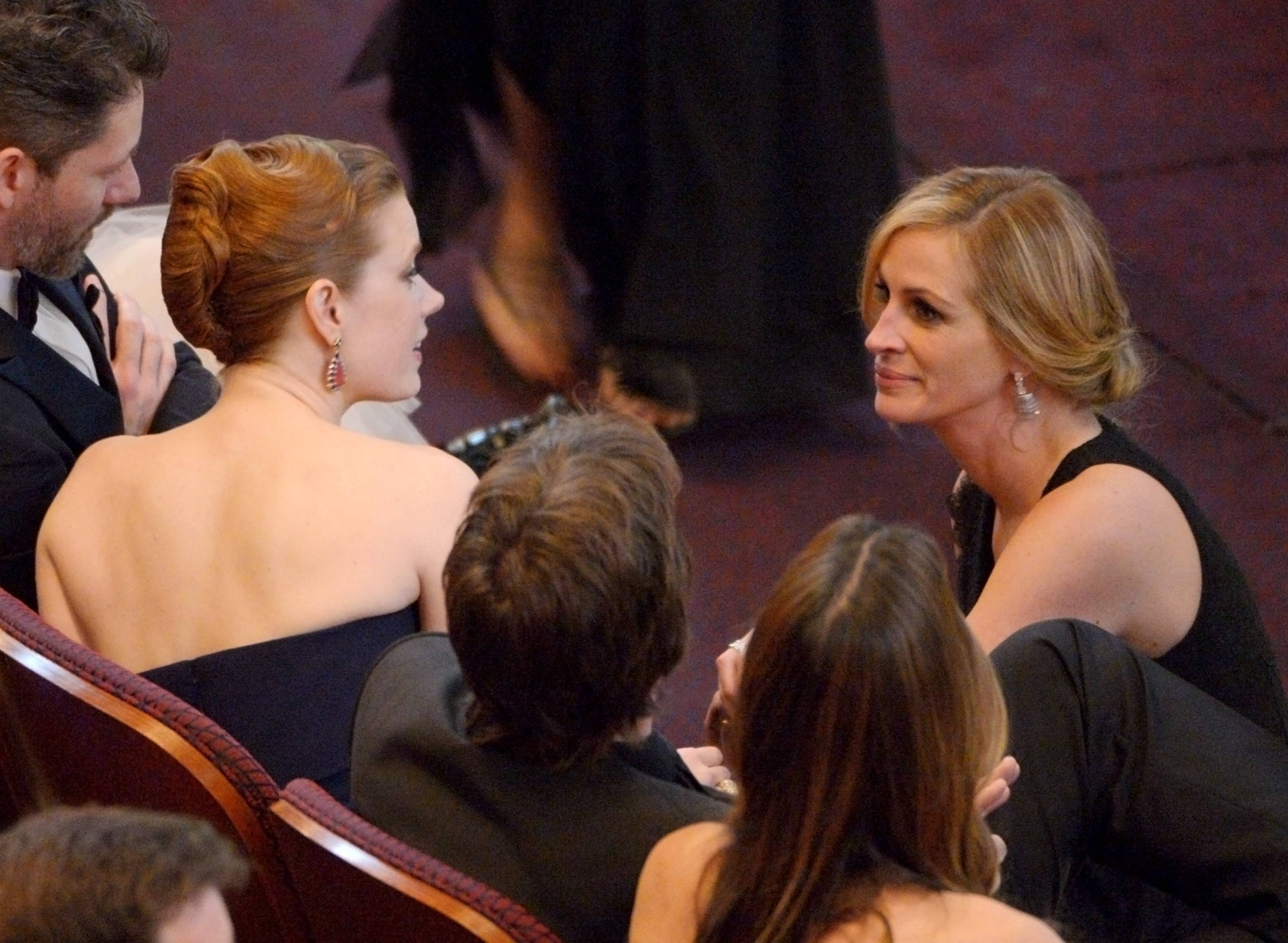 Amy Adams, left, and Julia Roberts are seen in the audience at the Oscars at the Dolby Theatre on Sunday in Los Angeles.