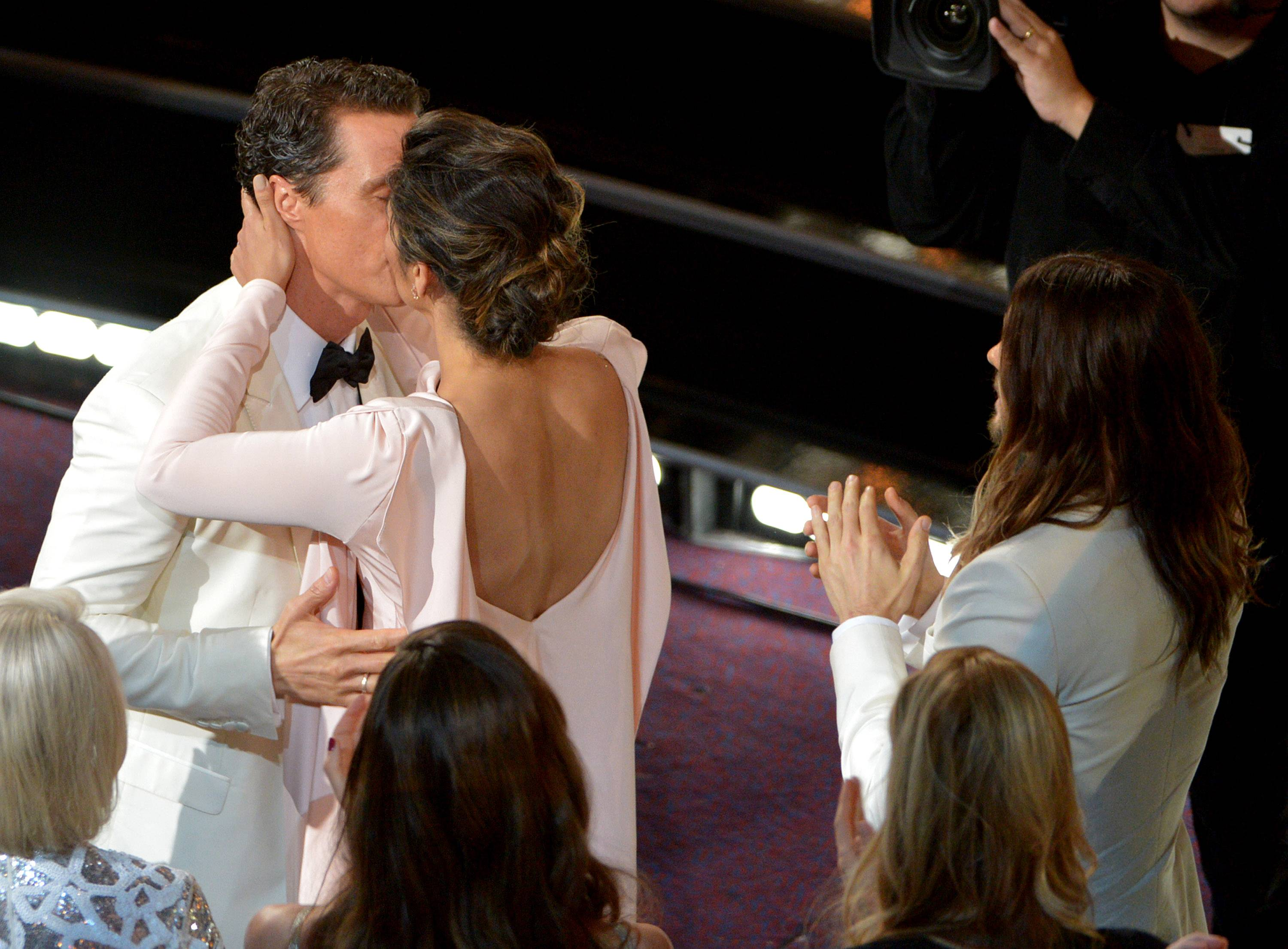 "Matthew McConaughey, left, kisses Camila Alves after winning the award for best actor in a leading role for ""Dallas Buyers Club."""
