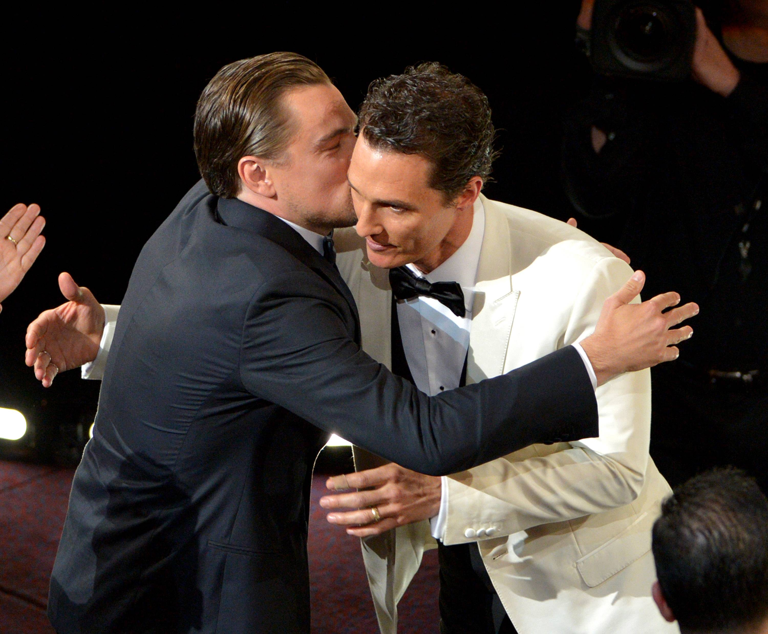 "Leonardo DiCaprio, left, congratulates Matthew McConaughey for winning the award for best actor in a leading role for ""Dallas Buyers Club.""  DiCaprio was also up for the award for his work in ""Wolf of Wall Street."""