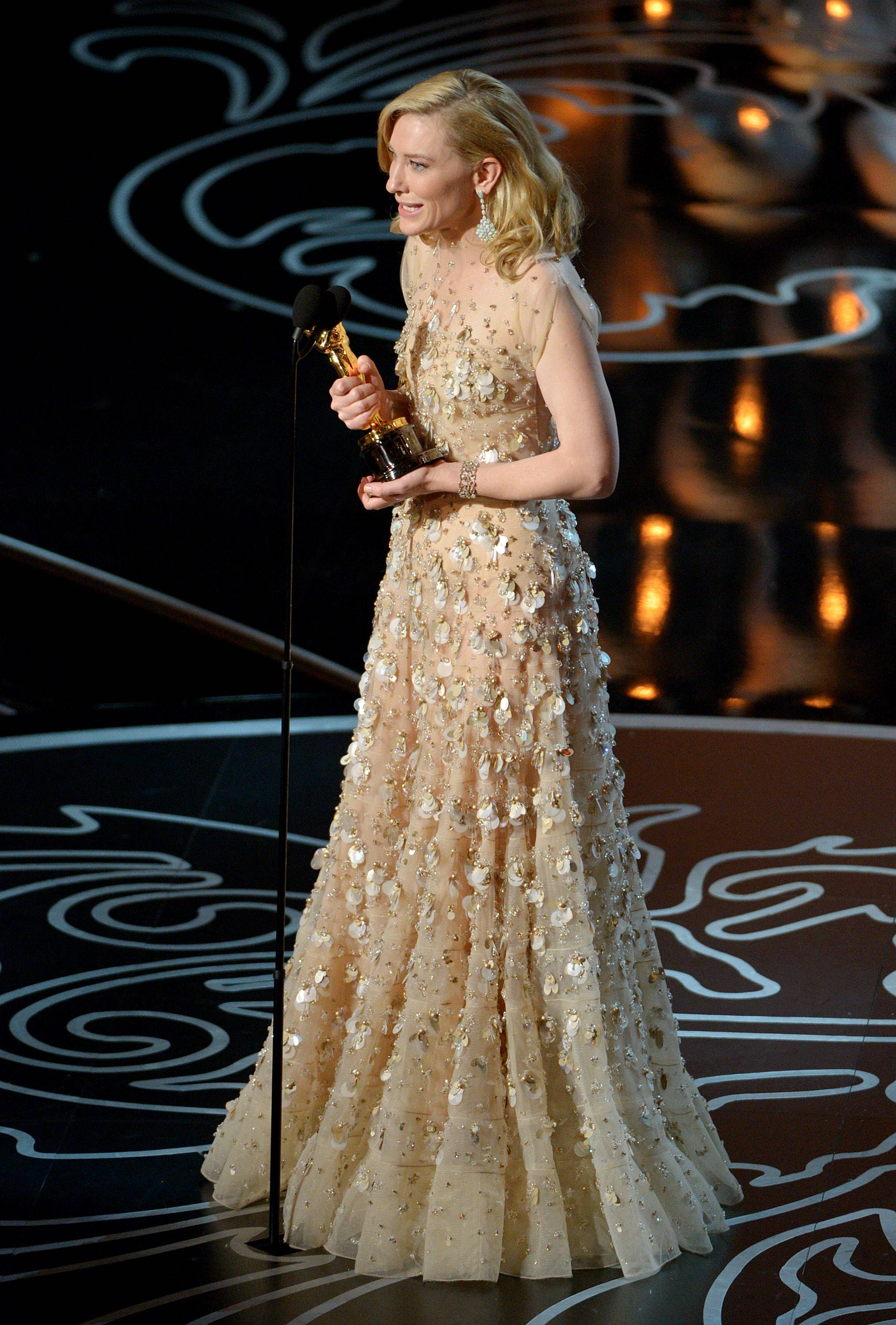 "Cate Blanchett accepts the award for best actress in a leading role for ""Blue Jasmine"" during the Oscars."