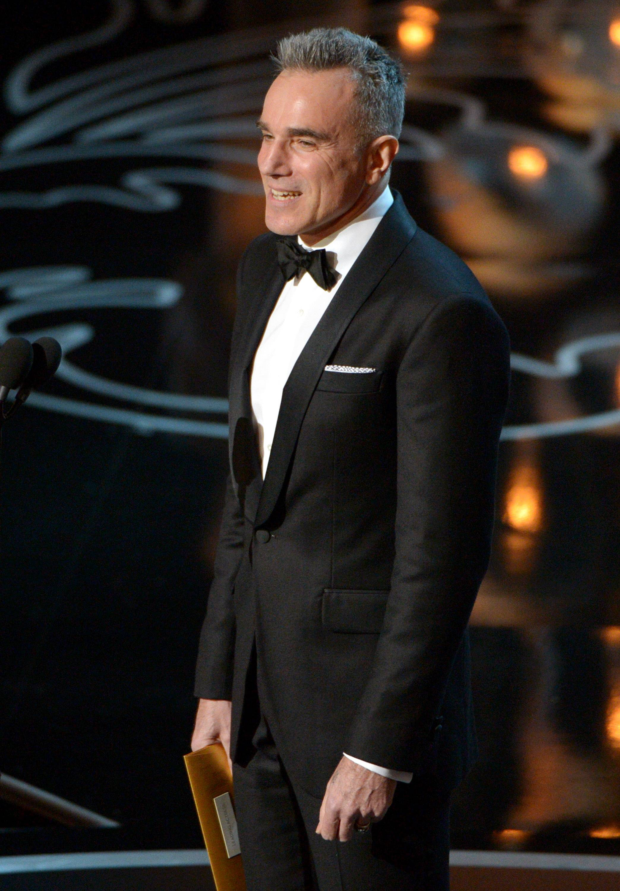 From Oscar winner last year to presenter this year, Daniel Day-Lewis speaks during the Oscars.