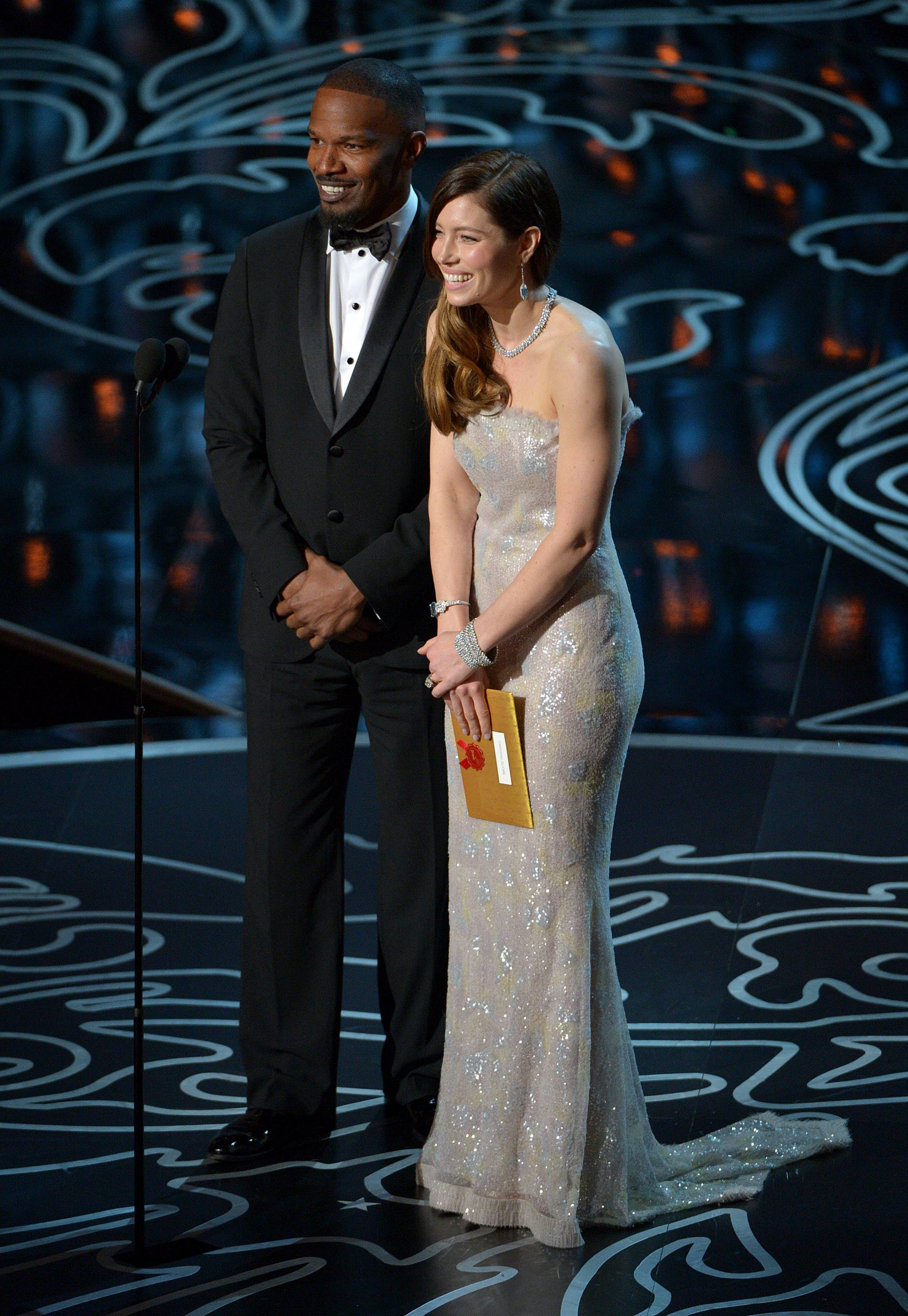 Jamie Foxx, left, and Jessica Biel speak during the Oscars at the Dolby Theatre on Sunday.