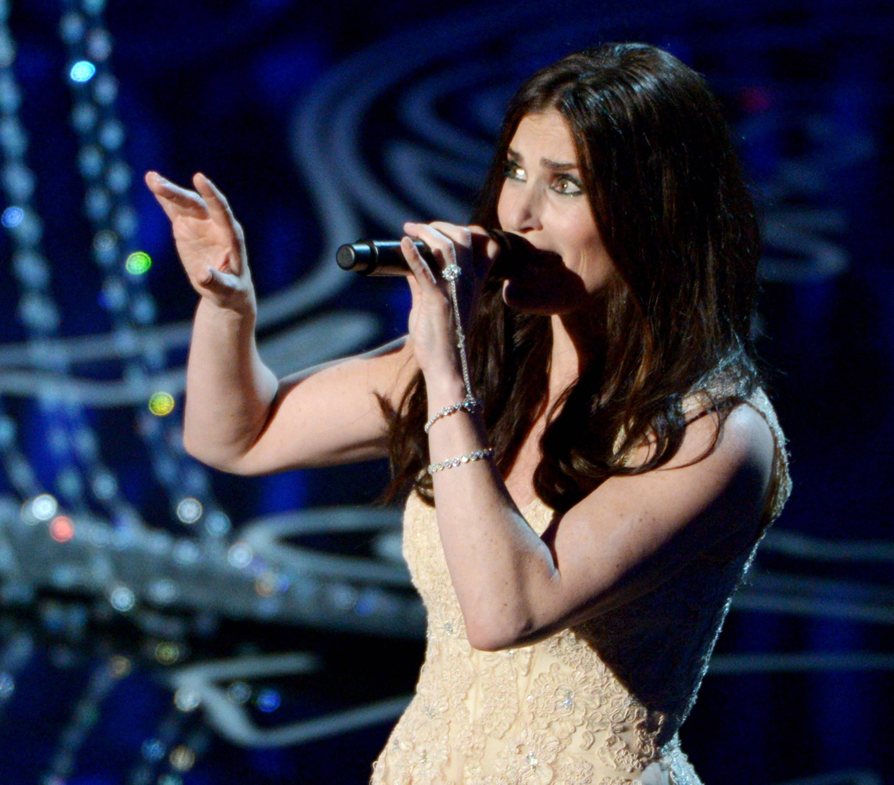 Idina Menzel performs on stage during the Oscars at the Dolby Theatre on Sunday.