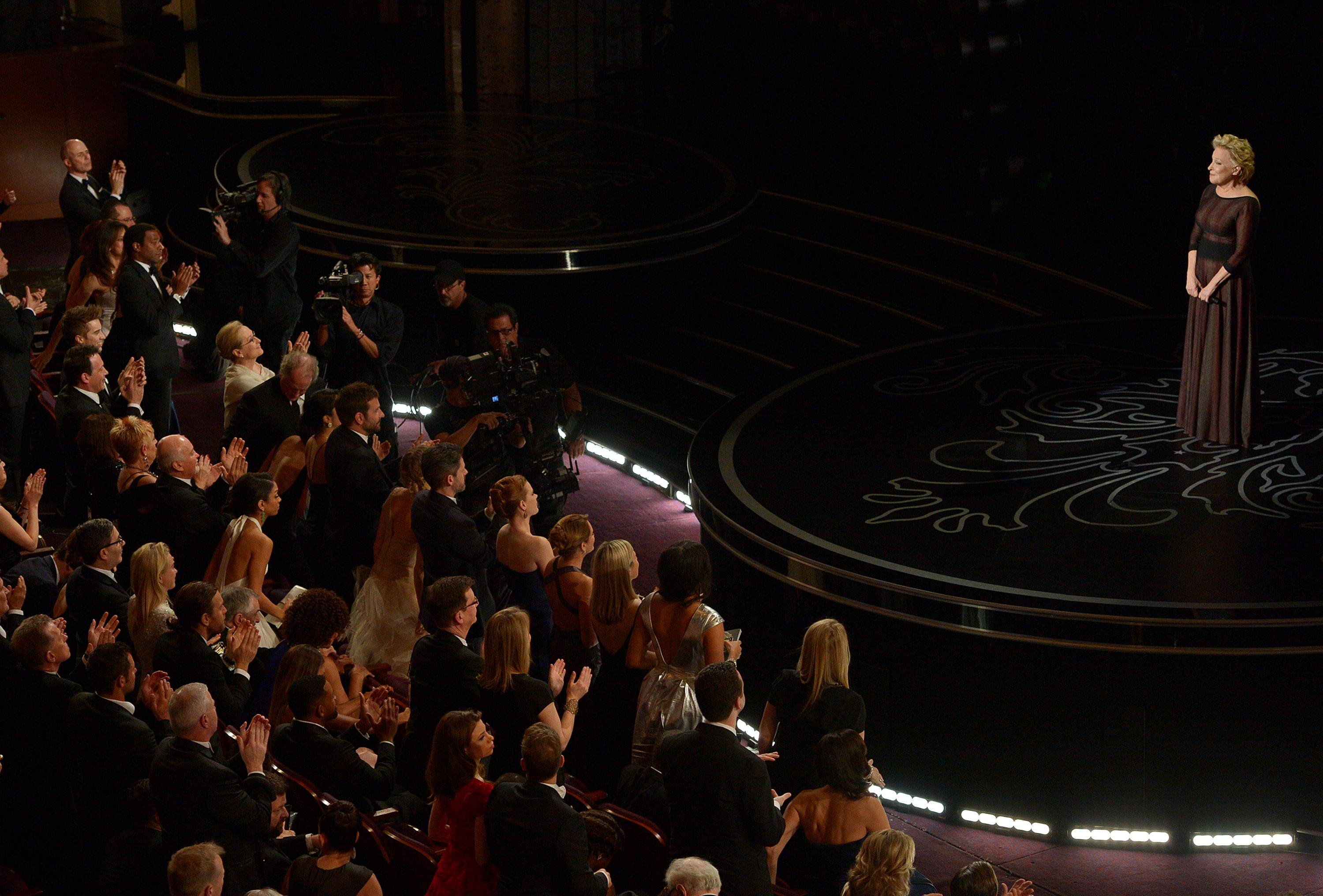 Bette Midler is applauded on stage after her performance during the In Memoriam segment at the Oscars.