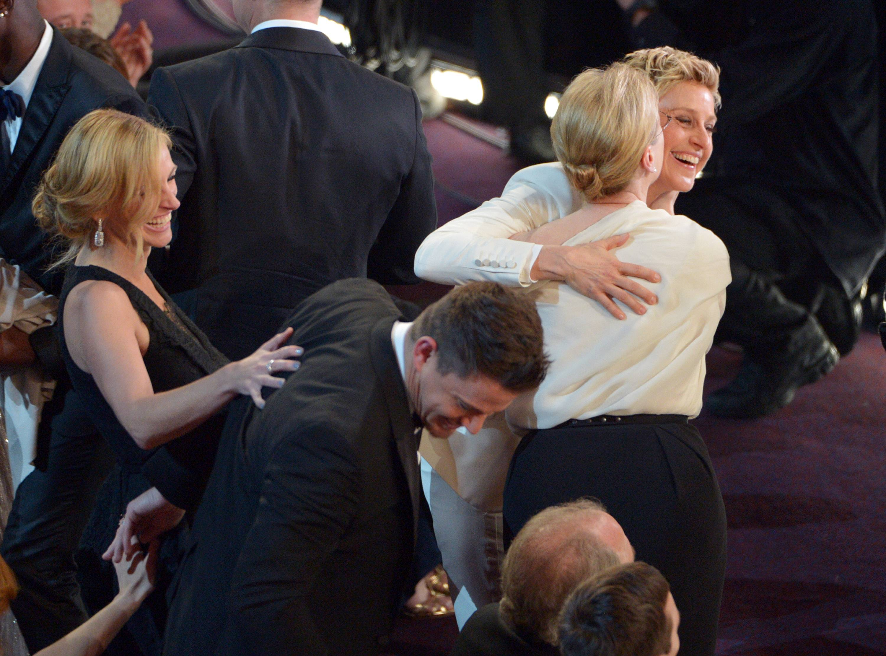 Julia Roberts, from left, Channing Tatumt, Meryl Streep and Ellen DeGeneres, laugh in the audience during the Oscars.