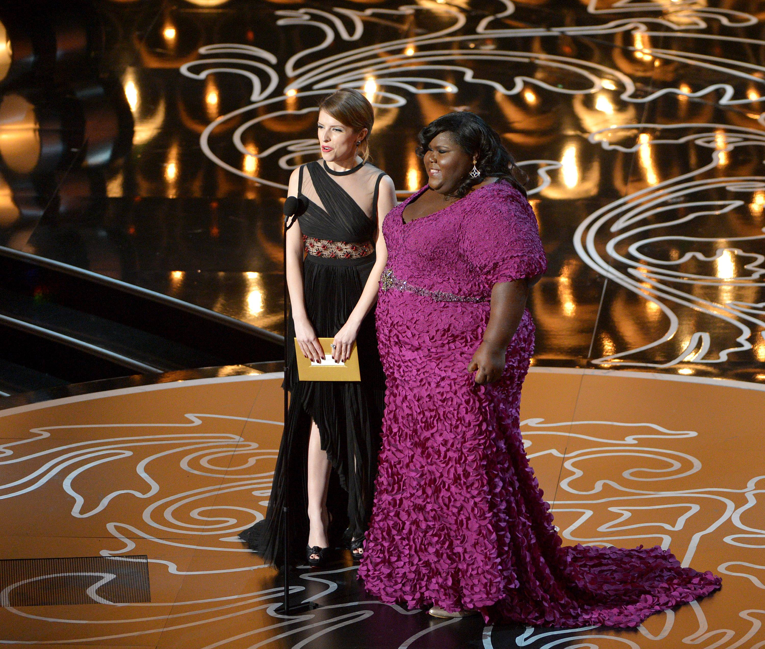 Presenters Anna Kendrick, left, and Gabourey Sidibe speak during the Oscars.