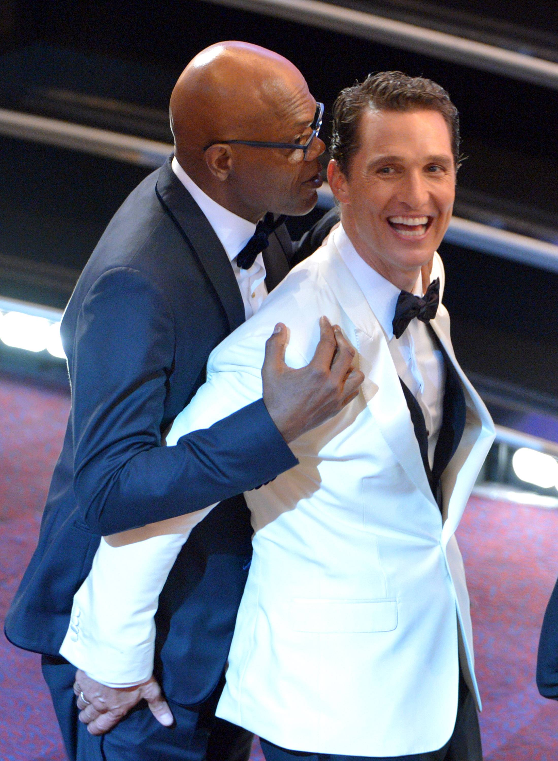 Samuel L. Jackson, left, and Matthew McConaughey embrace in the audience at the Oscars at the Dolby Theatre on Sunday in Los Angeles.