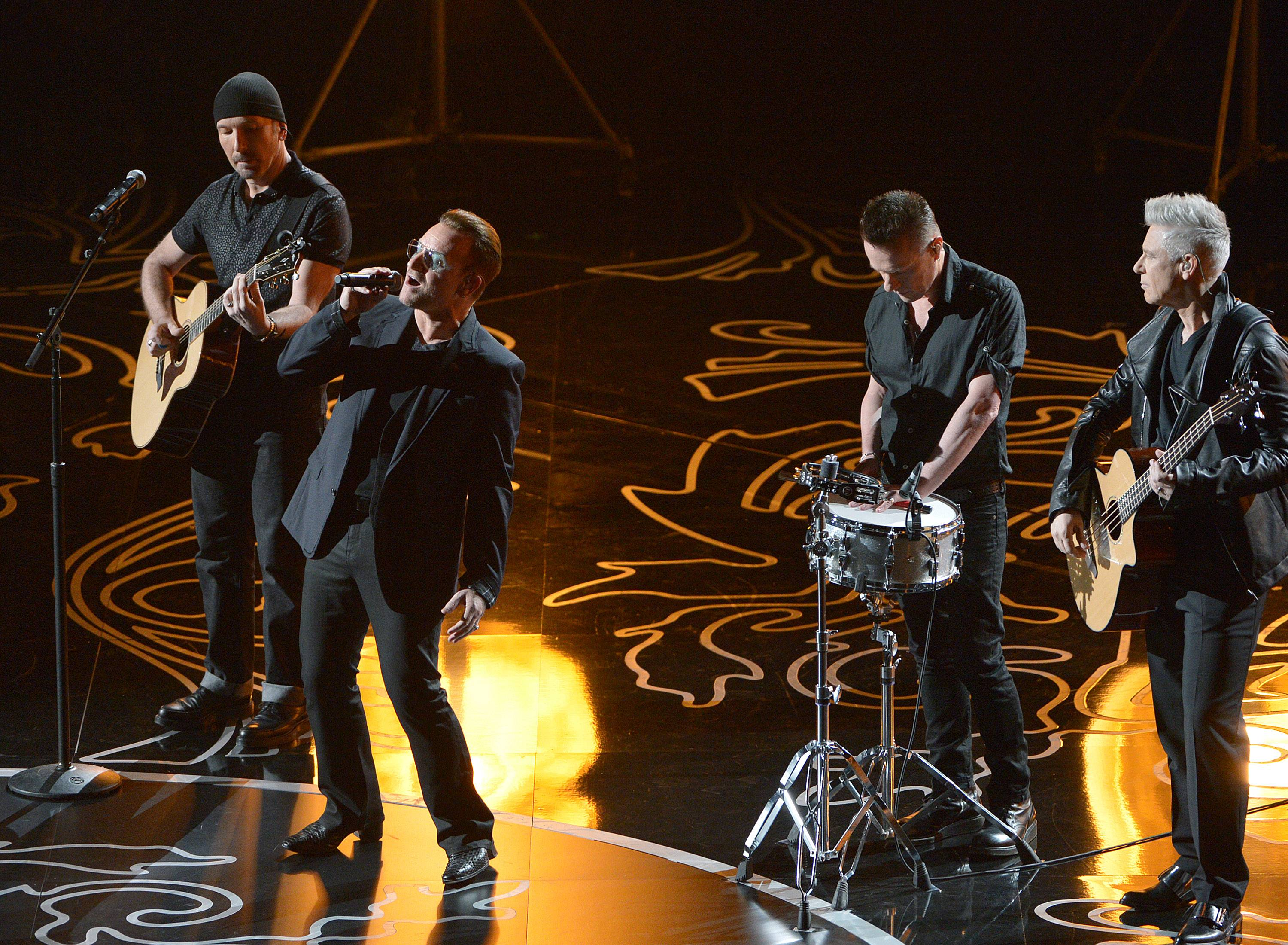 The Edge, from left, Bono, Larry Mullen, Jr. and Adam Clayton of U2 perform on stage during the Oscars.