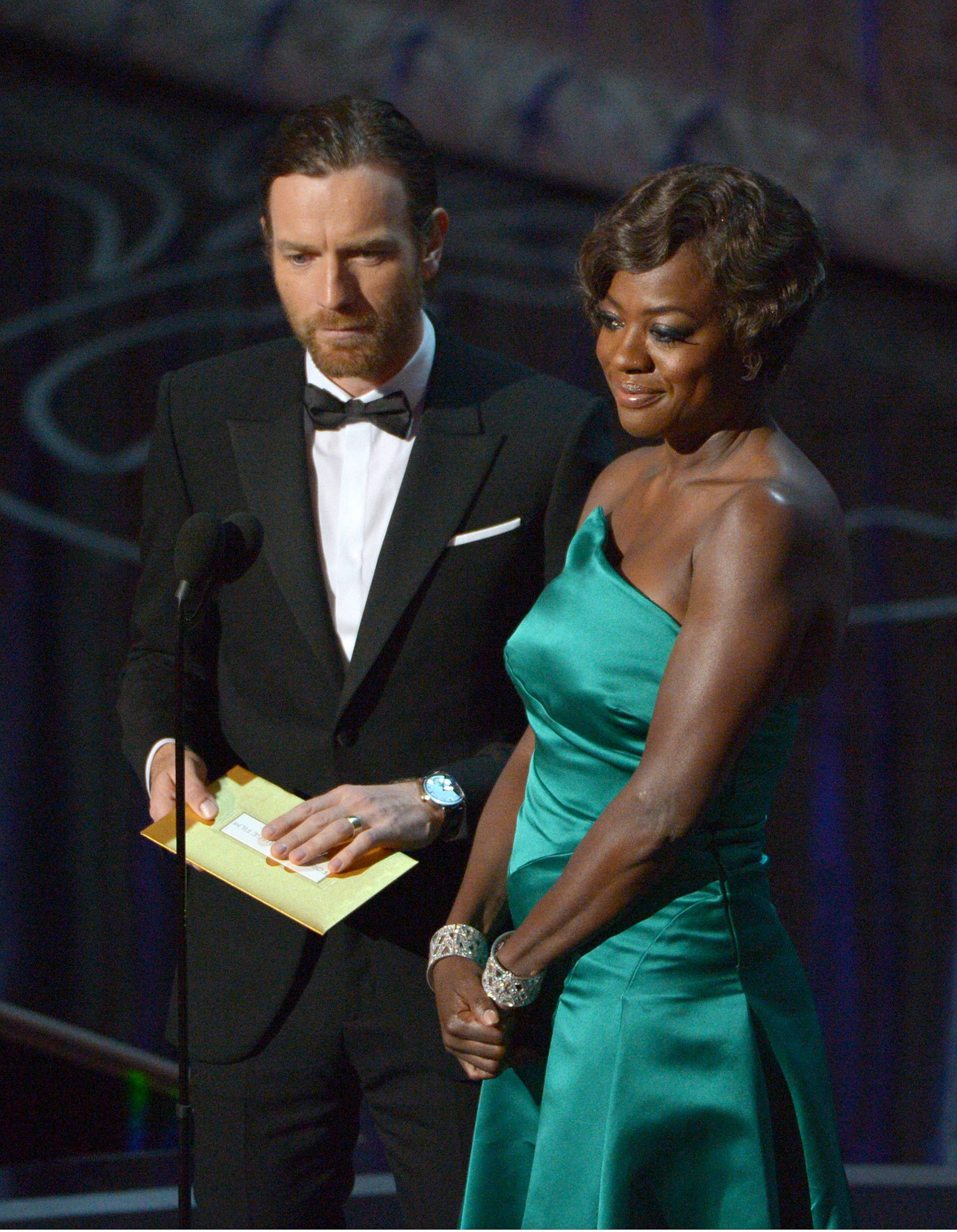 Ewan McGregor, left, and Viola Davis speak on stage during the Oscars.