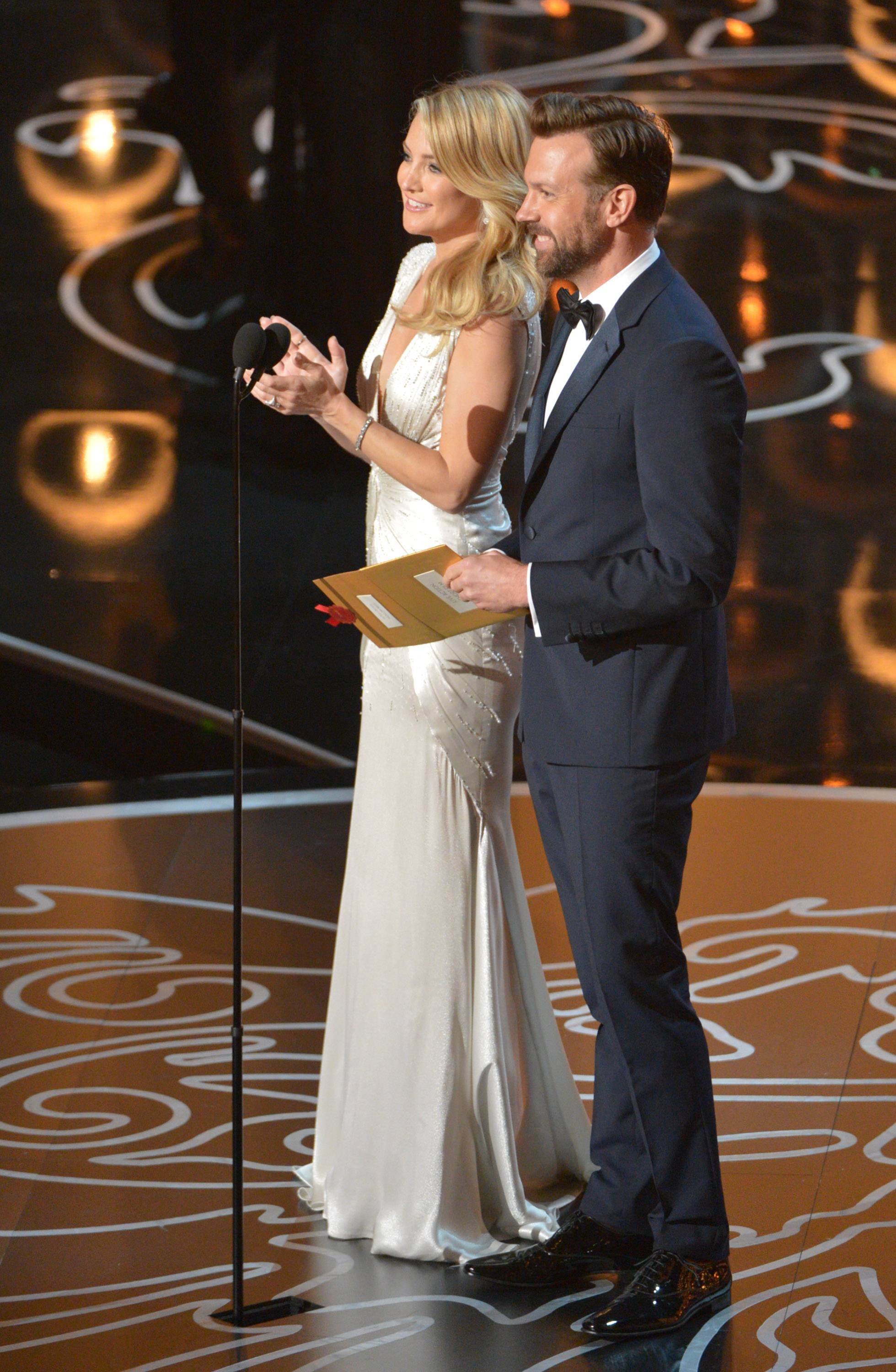 Presenters Kate Hudson, left, and Jason Sudeikis speak during the Oscars.