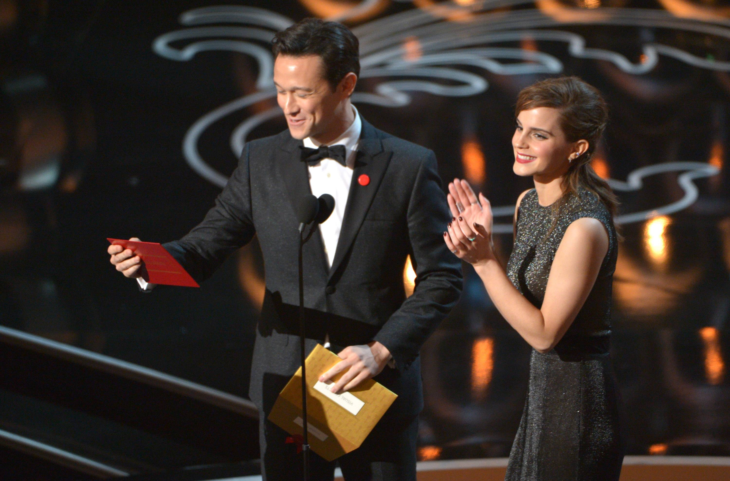 Joseph Gordon-Levitt, left, and Emma Watson present an award during the Oscars.