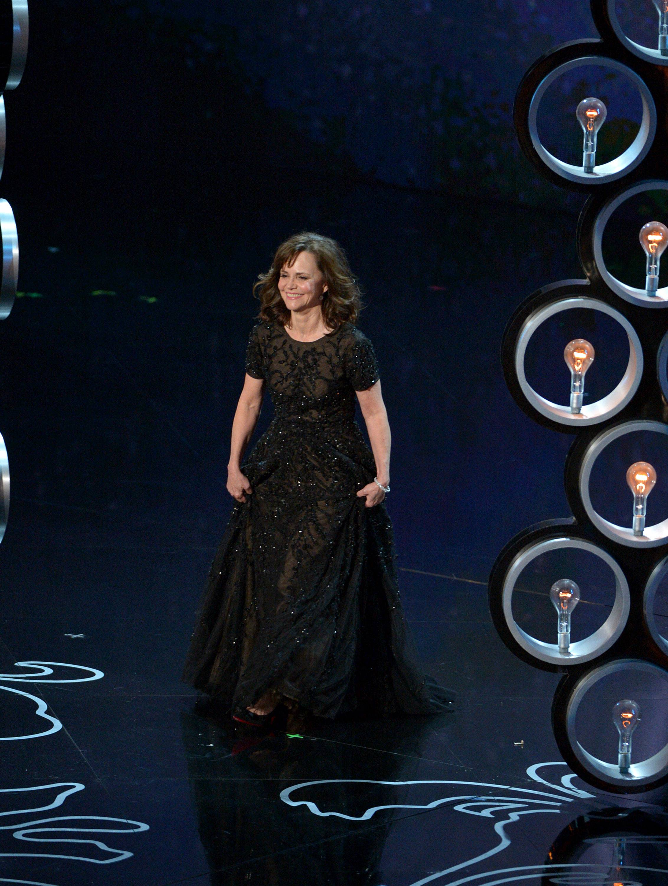 Sally Field walks on stage during the Oscars.