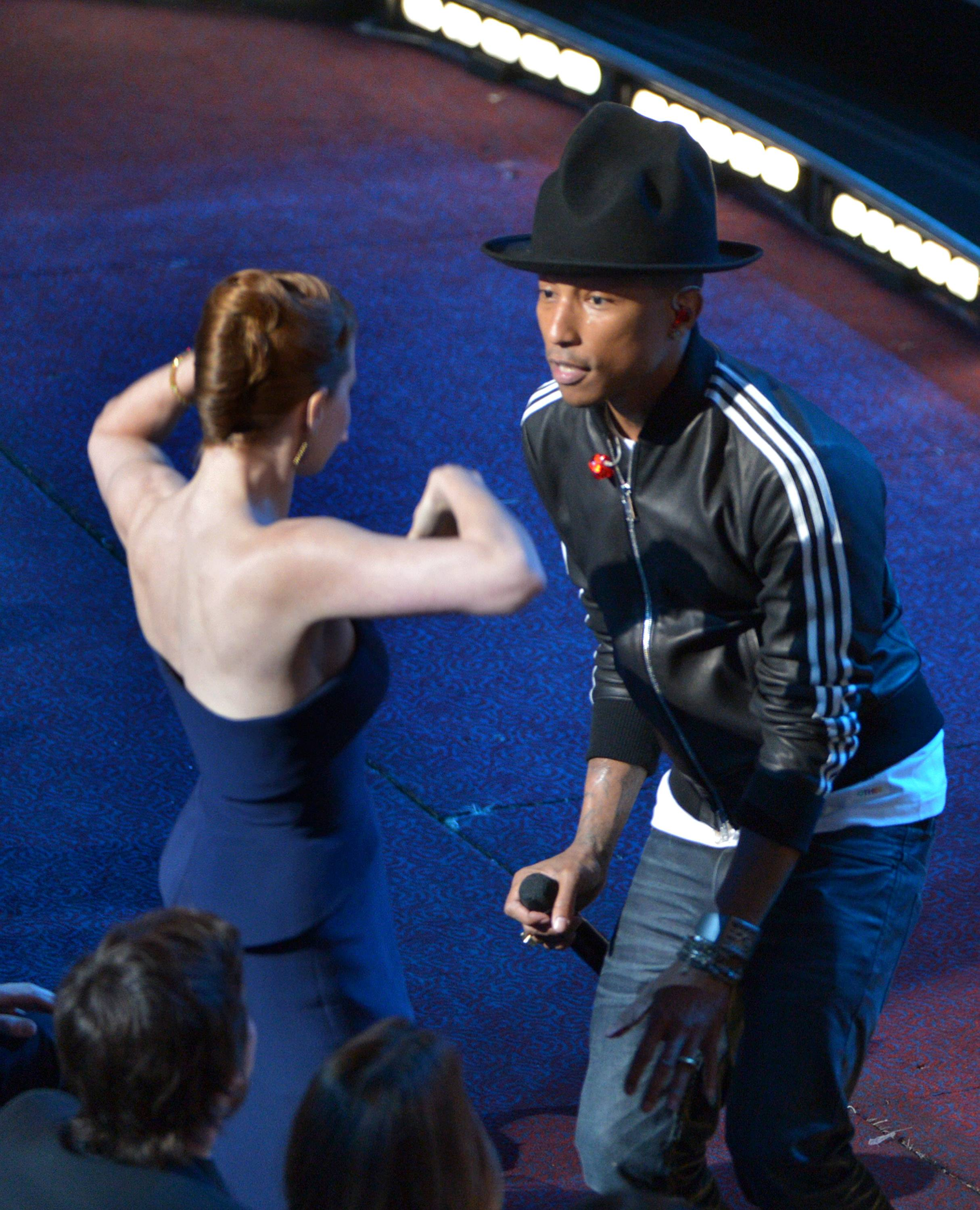 "Amy Adams, left, dances with Pharrell Williams during his performance of ""Happy"" at the Oscars."