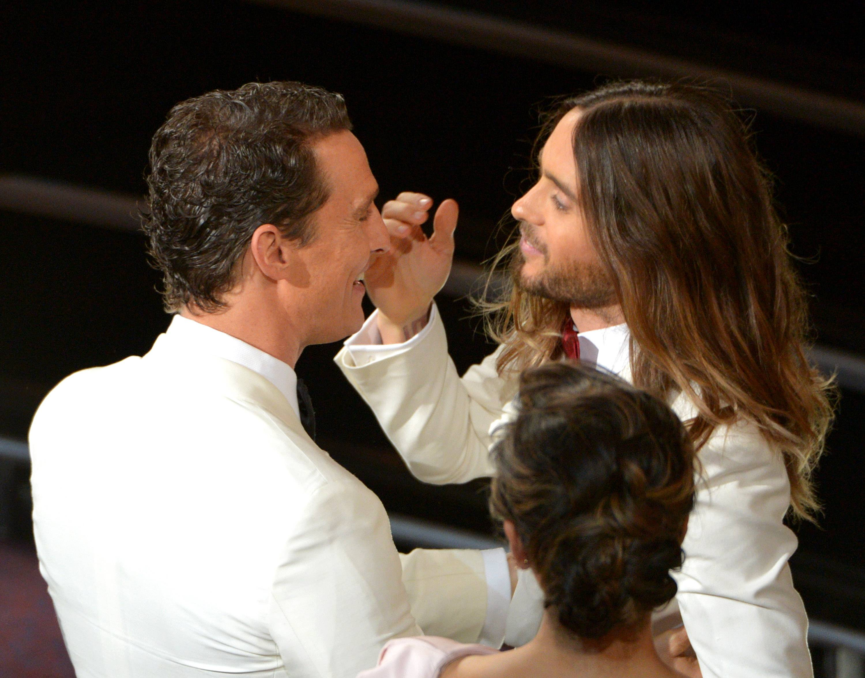 Matthew McConaughey, left, congratulates Jared Leto in the audience during the Oscars.