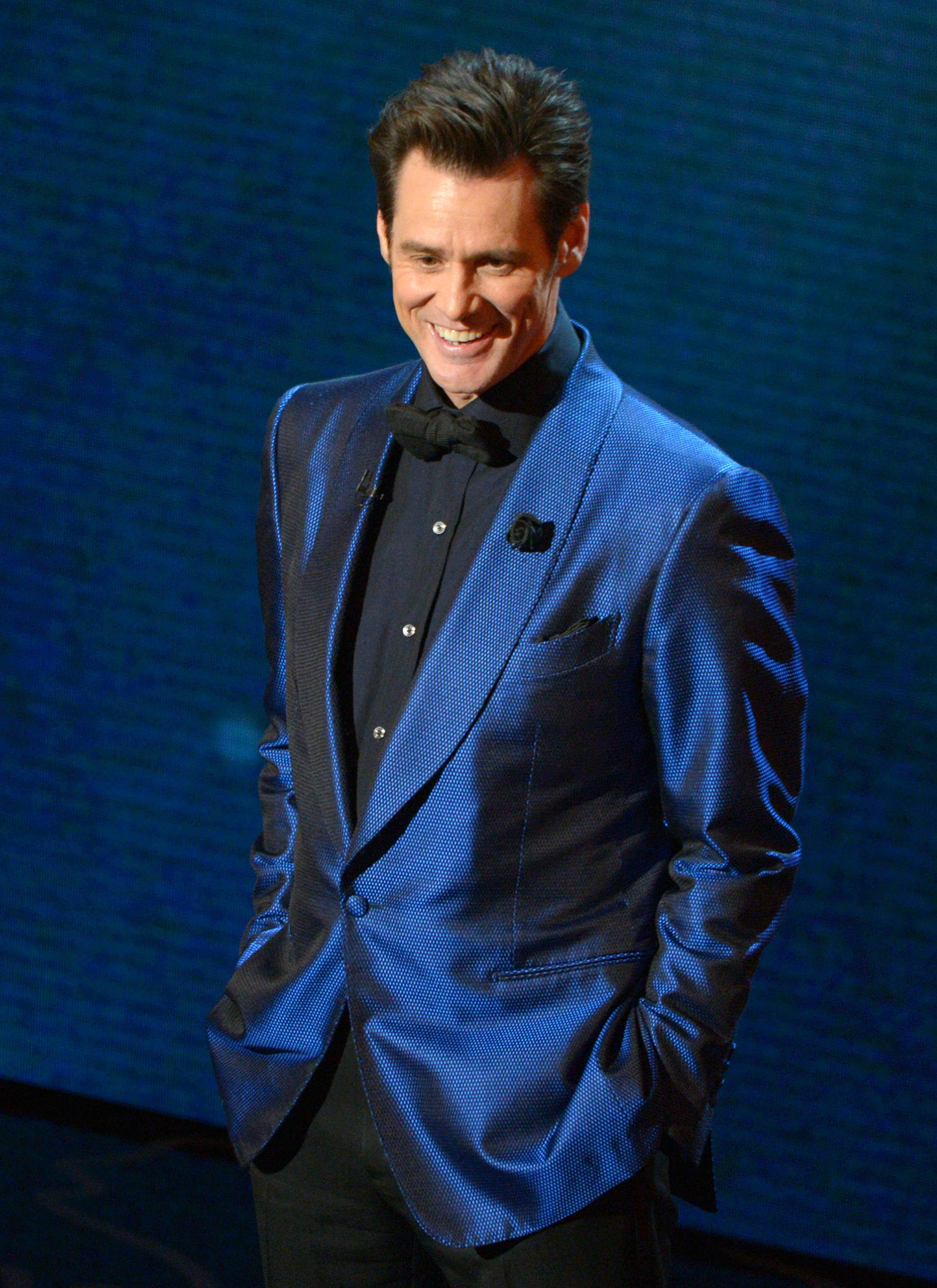 Jim Carrey speaks on stage during the Oscars at the Dolby Theatre on Sunday.