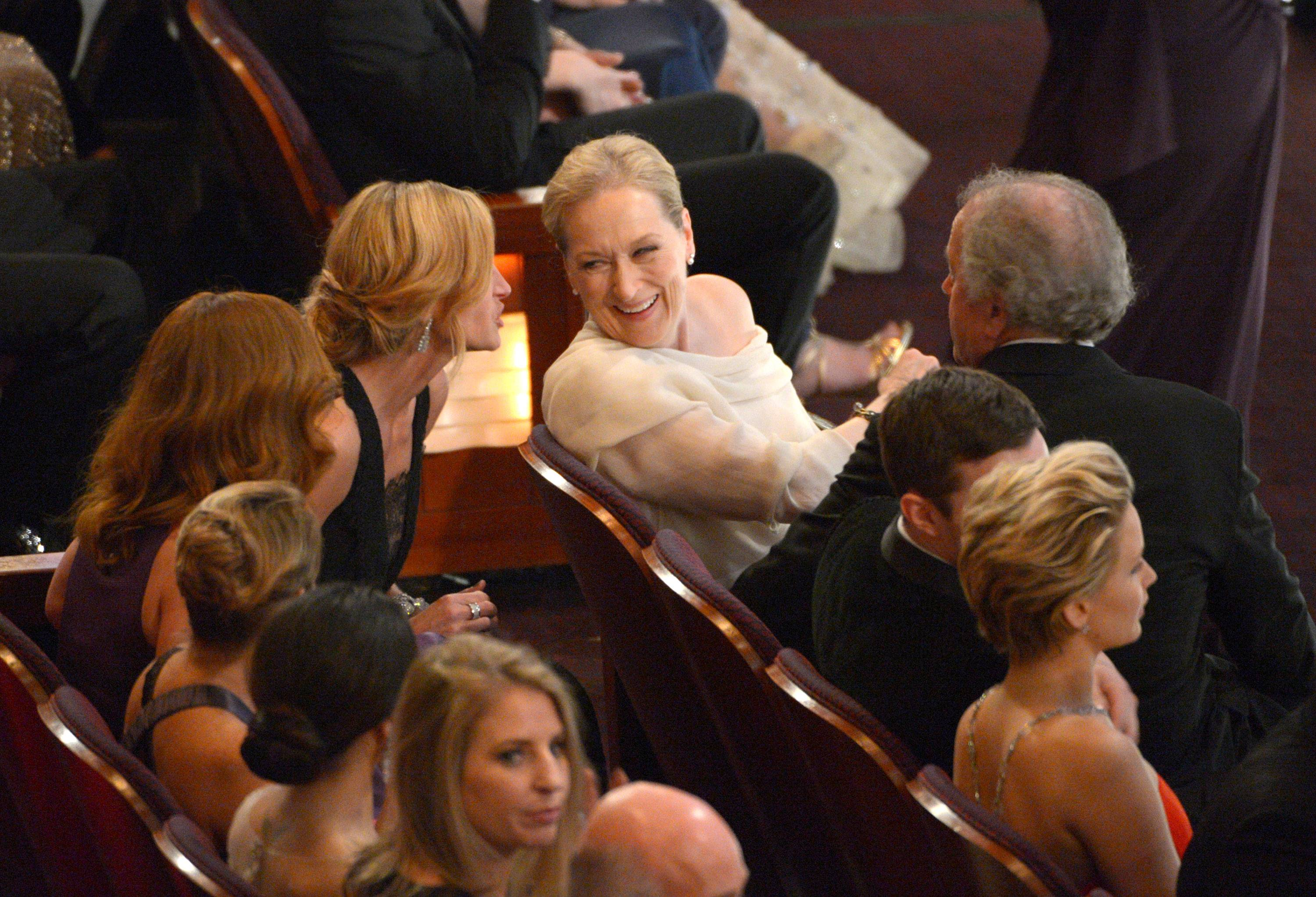 """August Osage County"" co-stars Julia Roberts, left, and Meryl Streep are seen in the audience at the Oscars at the Dolby Theatre on Sunday in Los Angeles."