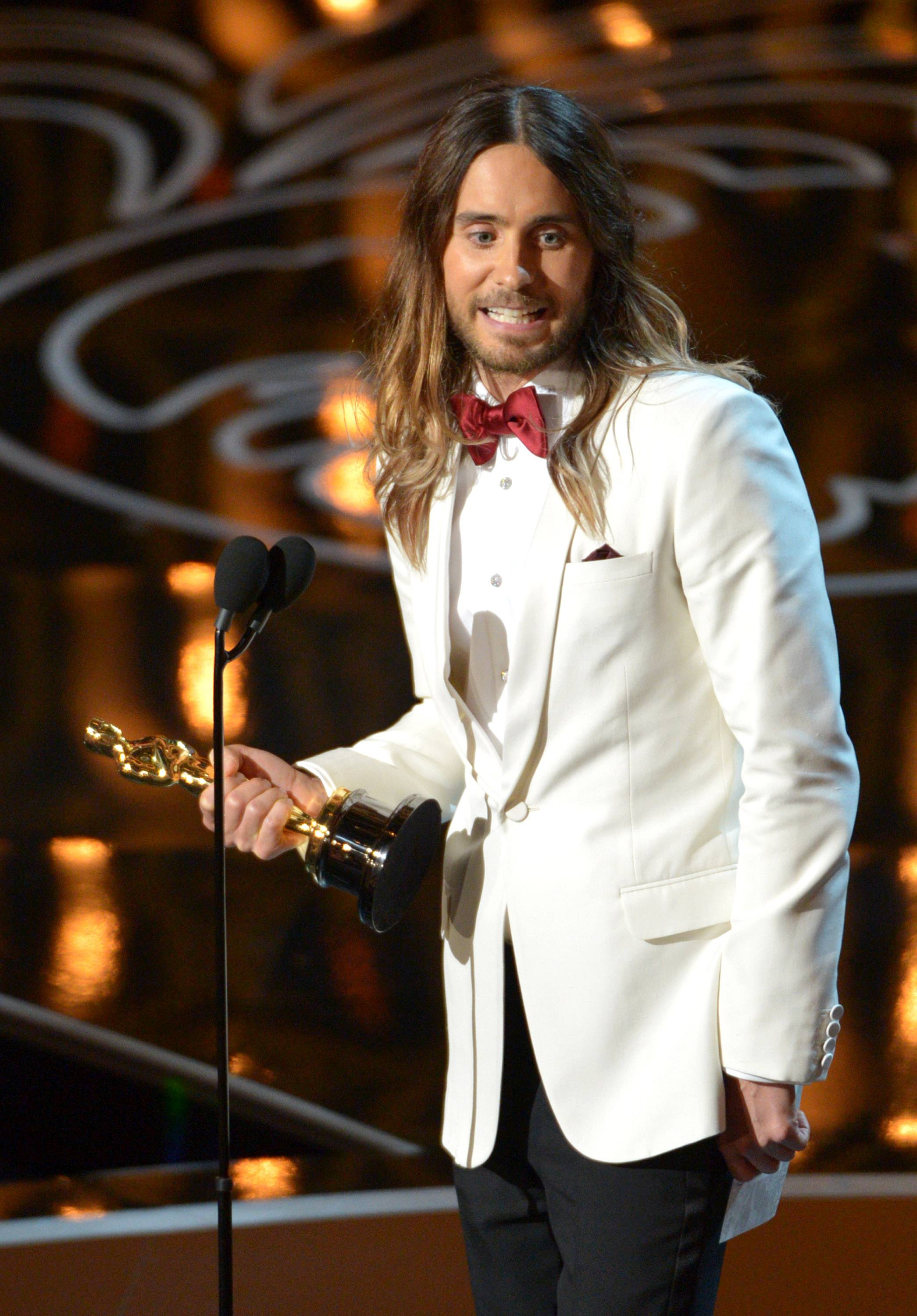 "Jared Leto accepts the award for best actor in a supporting role for ""Dallas Buyers Club"" during the Oscars."