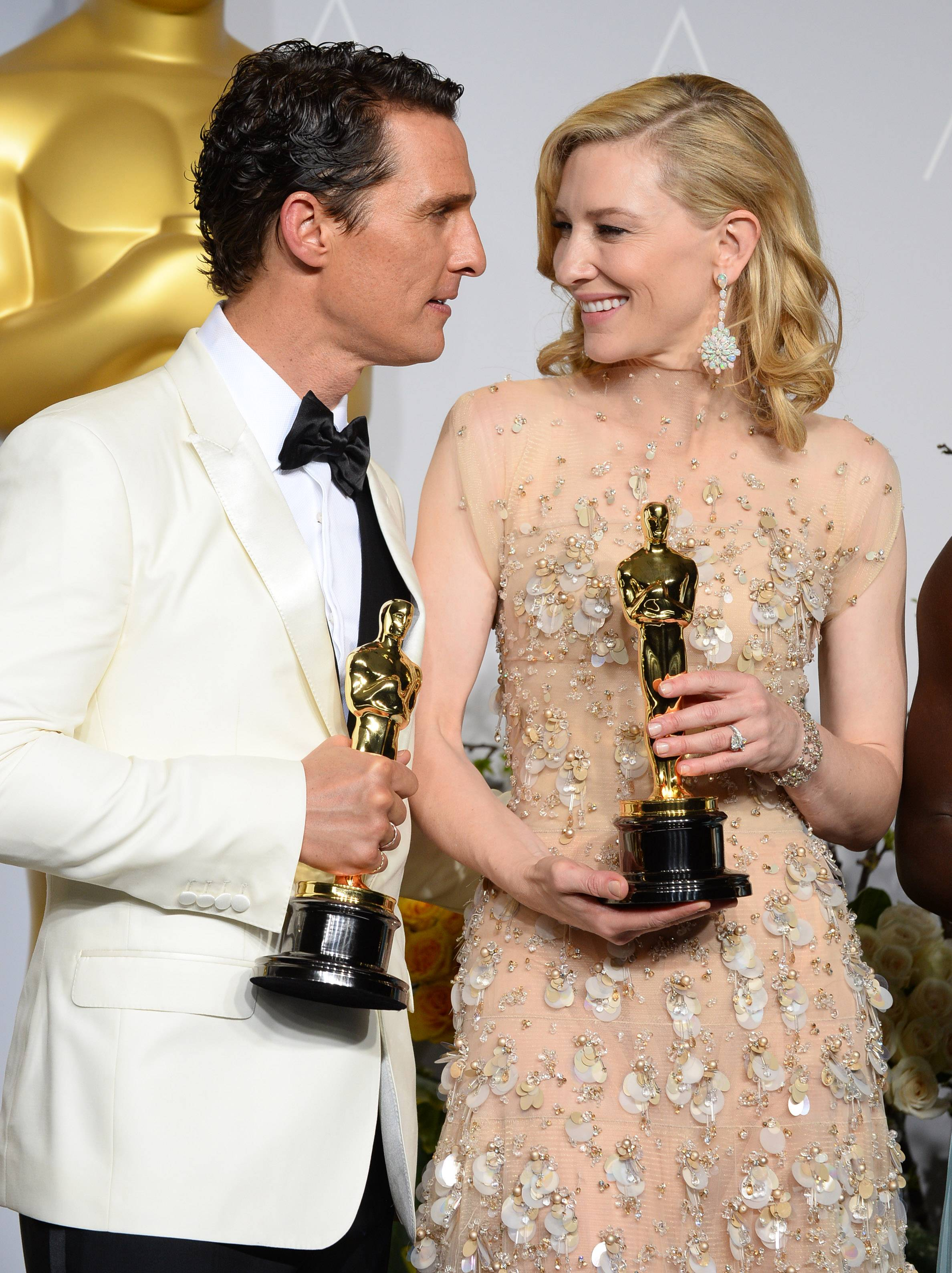 "Matthew McConaughey, left, holding his award for best actor for his role in ""Dallas Buyers Club,"" poses with Cate Blanchett, with her award for best actress for her role in ""Blue Jasmine,"" in the press room during the Oscars."