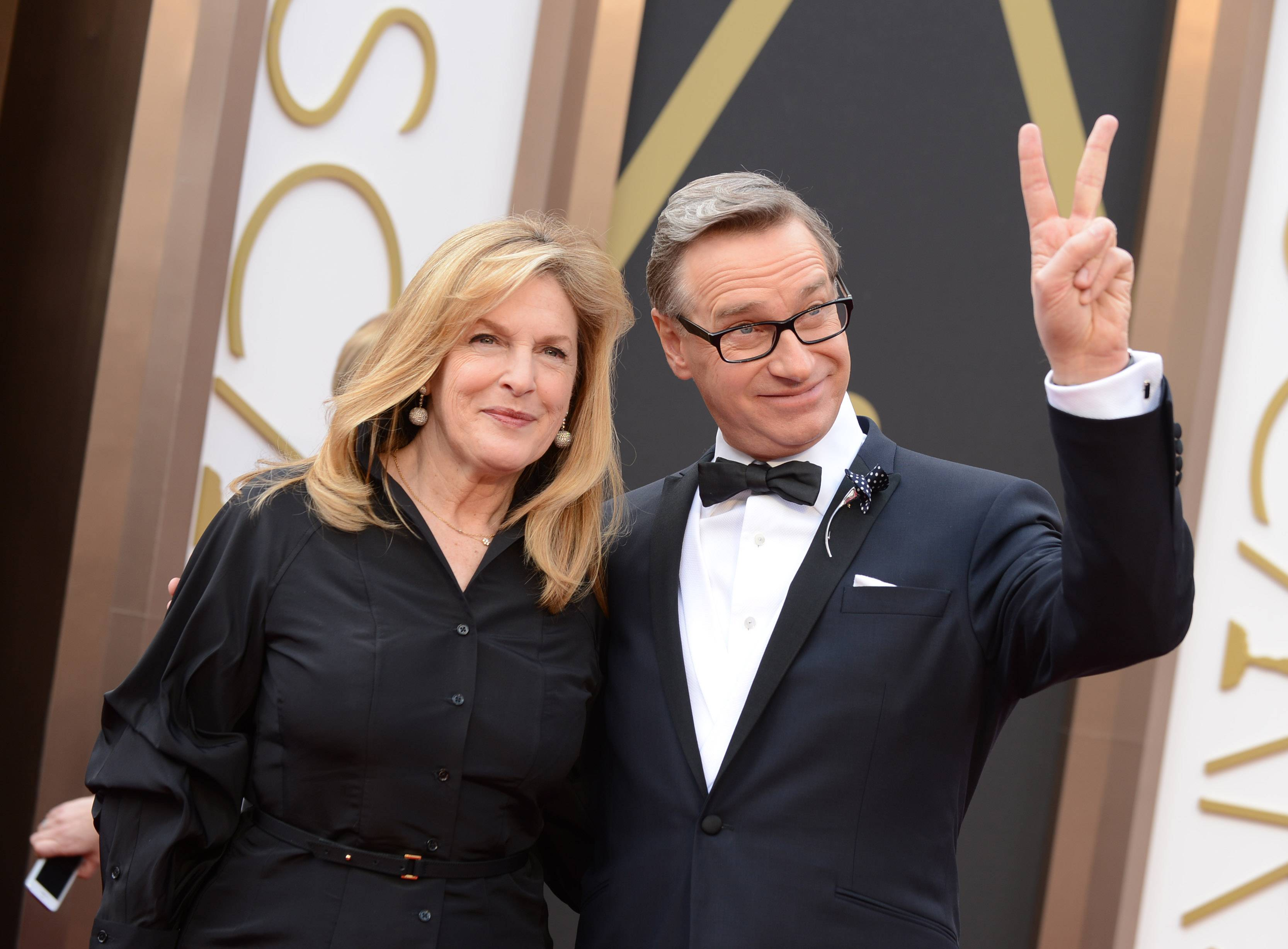 Laurie Karon and director Paul Feig arrive at the Oscars on Sunday at the Dolby Theatre in Los Angeles.
